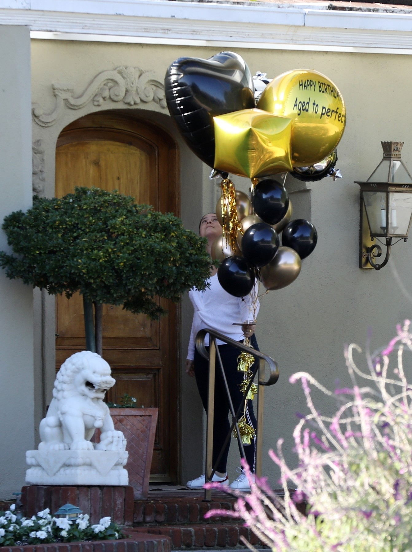 Los Angeles, CA  - Kirk Douglas gets birthday balloons delivered with
