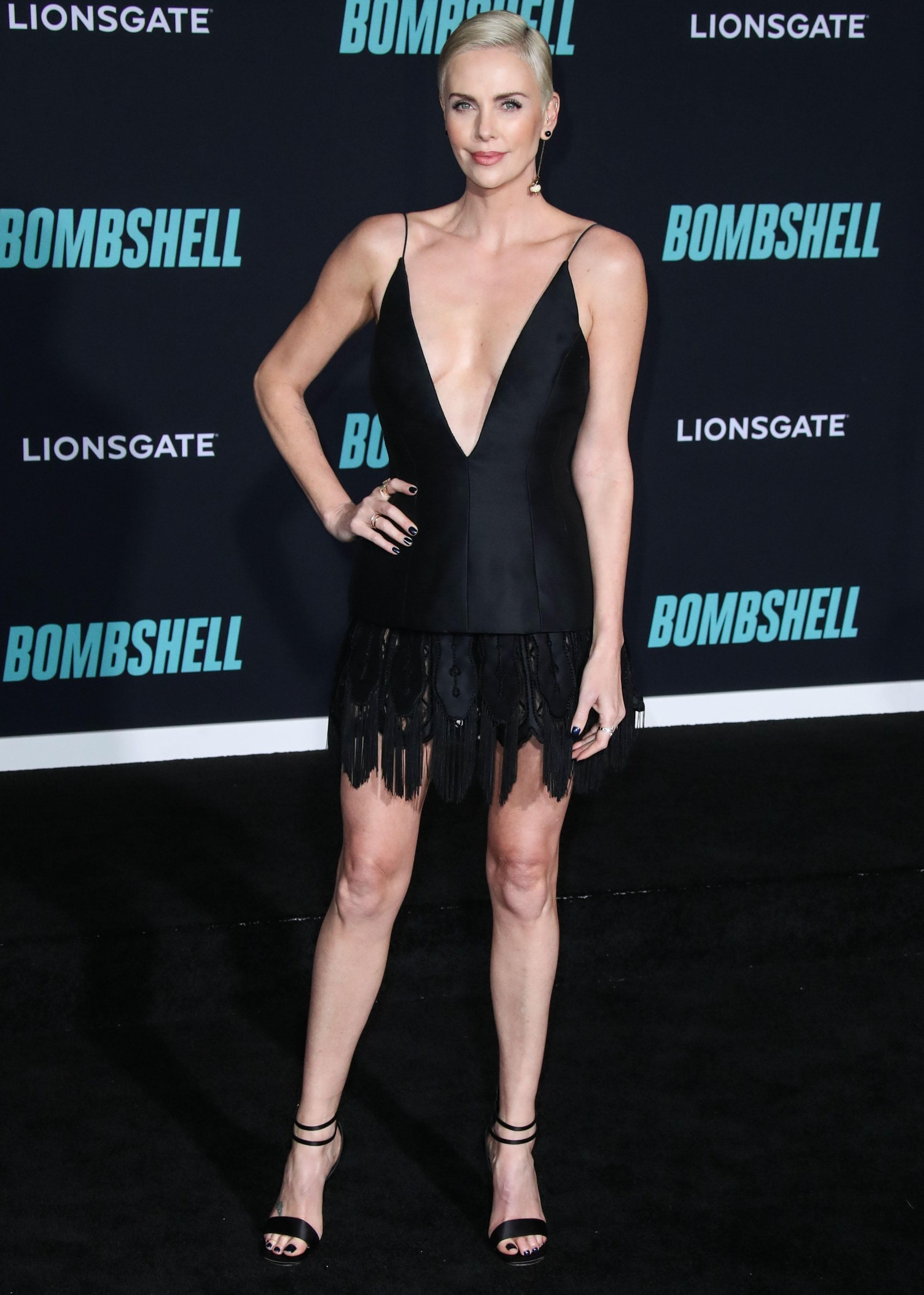 WESTWOOD, LOS ANGELES, CALIFORNIA, USA - DECEMBER 10: Actress Charlize Theron wearing Custom Christian Dior with Retrouvai and EF Collection rings arrives at the Los Angeles Special Screening Of Liongate's 'Bombshell' held at the Regency Village Theatre on December 10, 2019 in Westwood, Los Angeles, California, United States., Image: 487573670, License: Rights-managed, Restrictions: , Model Release: no, Credit line: ImagePressAgency/face to face / Face to Face / Profimedia