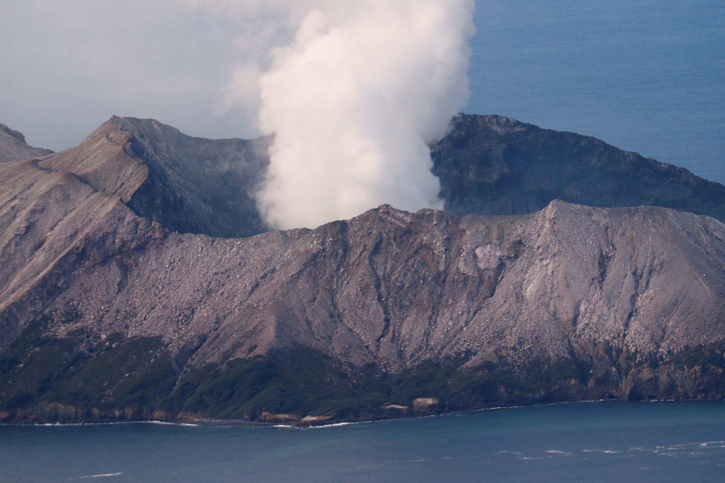 An aerial view of the Whakaari, also known as White Island volcano, as seen from Ohope beach in Whakatane, New Zealand, December 12, 2019. REUTERS/Jorge Silva