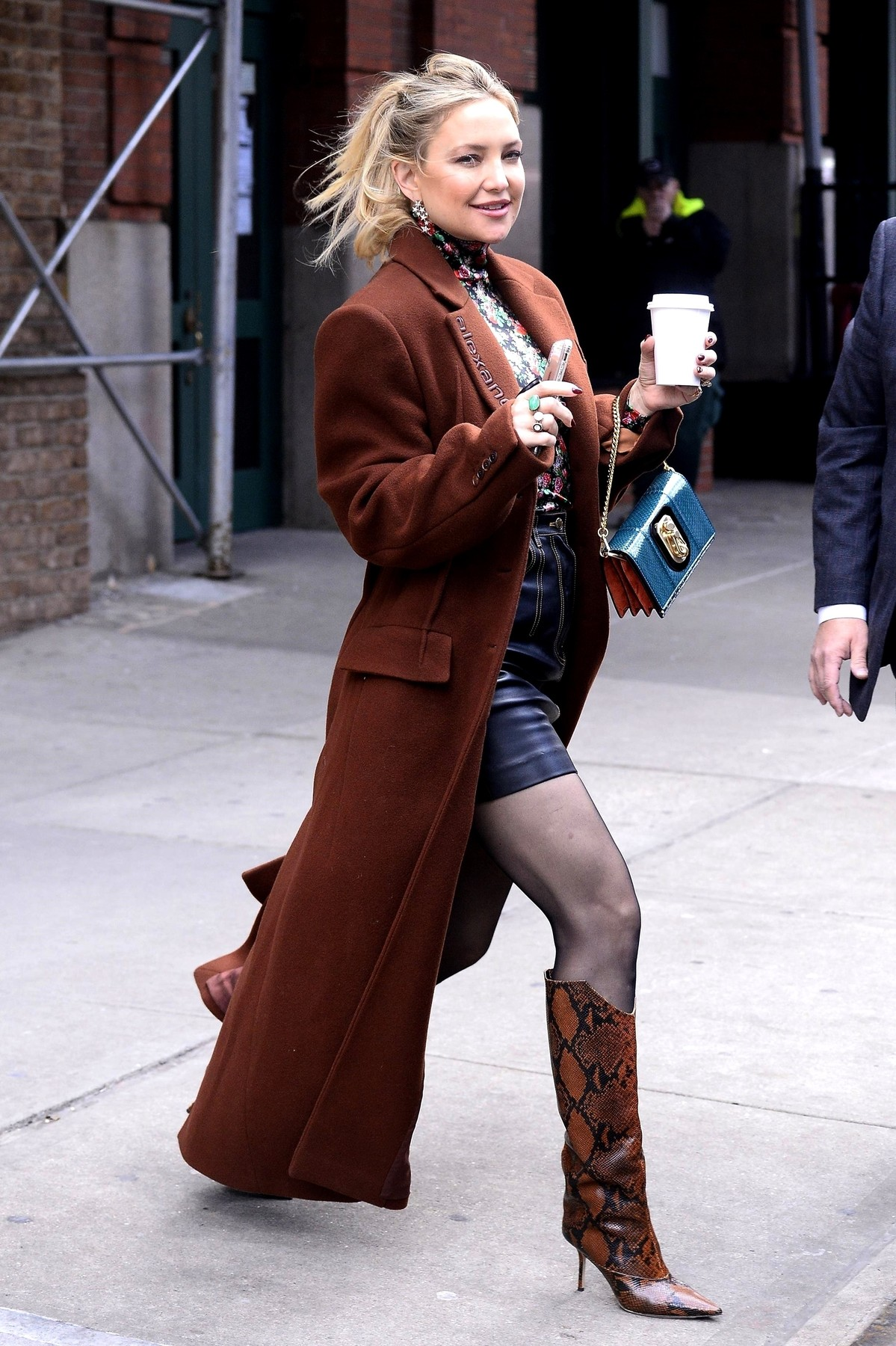 New York, NY  - *EXCLUSIVE*  - Actress Kate Hudson seen exiting the The Greenwich Hotel this morning with a coffee in hand and her signature bright smile in tow.  The mother of three looked chic in a Alexander Wang trench over a floral blouse with leather skirt, black stockings and snake skin boots for her day in the city.  *UK Clients - Pictures Containing Children Please Pixelate Face Prior To Publication*, Image: 486559773, License: Rights-managed, Restrictions: , Model Release: no, Credit line: JosiahW / BACKGRID / Backgrid USA / Profimedia