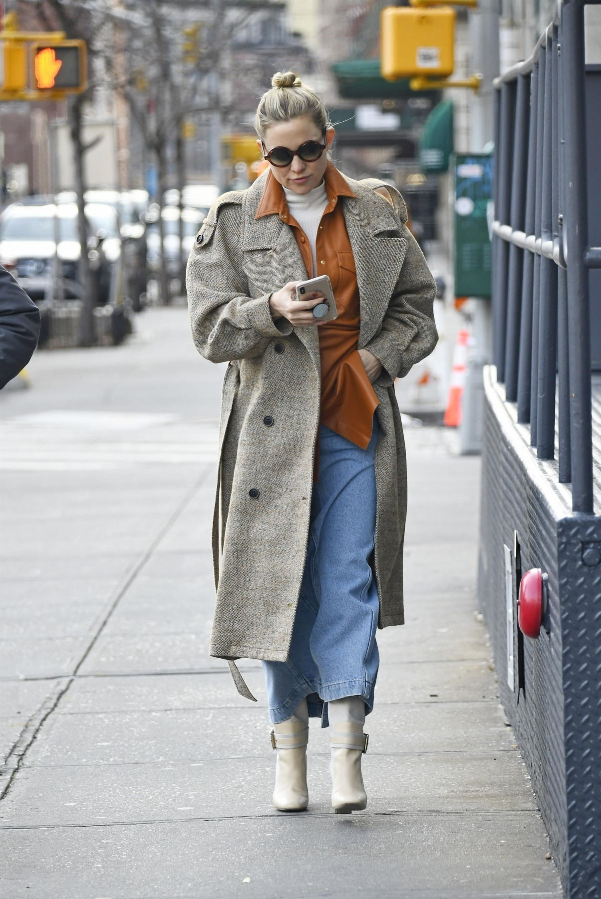 New York, NY  - Fashionable Kate Hudson takes a phone call while bundled up on a walk in NYC. The actress and designer wore a herringbone peacoat over denim skirt, beige boots and and orange rust collared shirt  *UK Clients - Pictures Containing Children Please Pixelate Face Prior To Publication*, Image: 487020215, License: Rights-managed, Restrictions: , Model Release: no, Credit line: BACKGRID / Backgrid USA / Profimedia