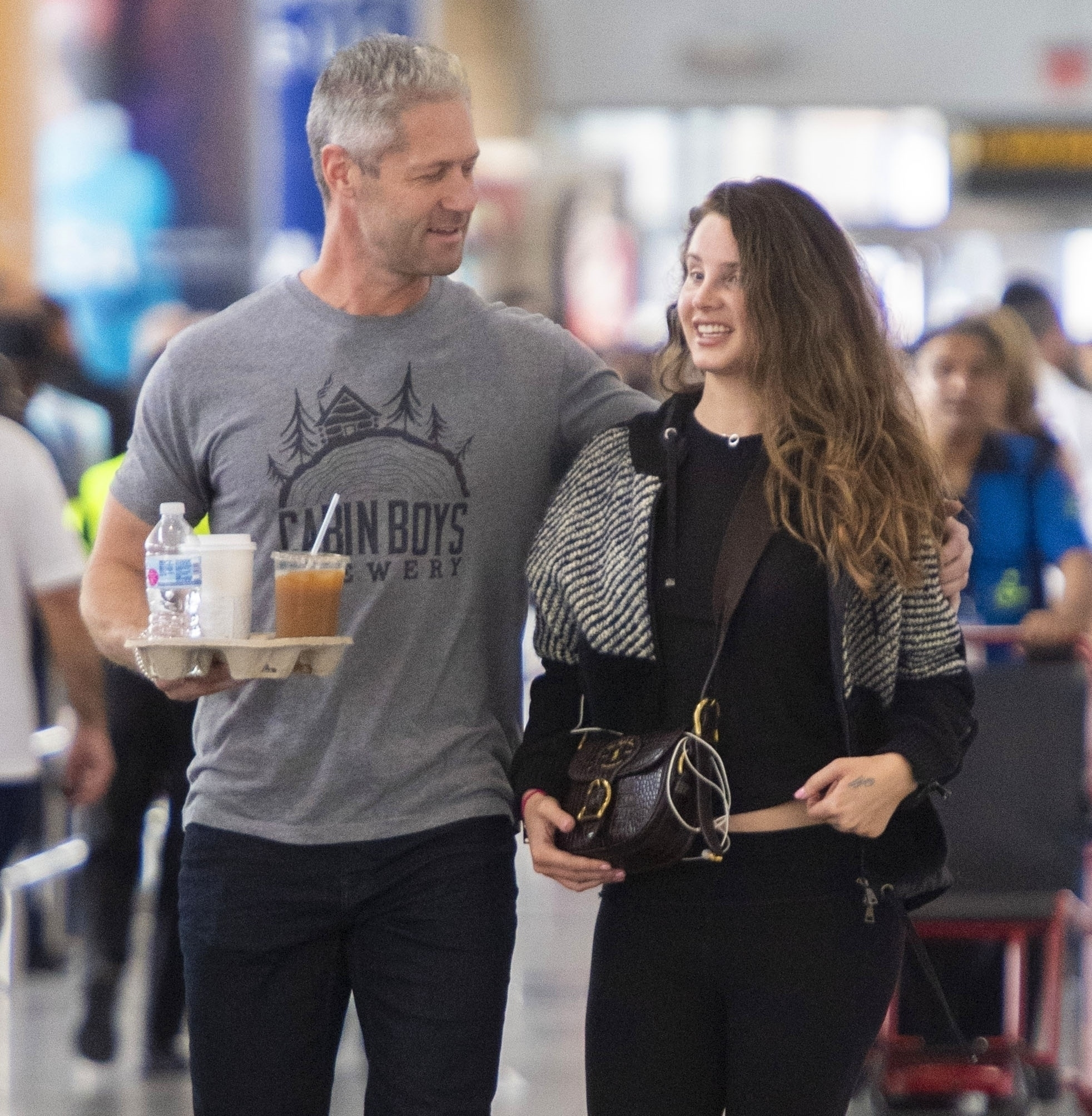 New York, NY  - *EXCLUSIVE*  -Songstress Lana Del Rey arrives with cop influencer boyfriend Sean Larkin at the JFK airport in NYC. The couple look smitten as they move through the terminal with coffee and water in hand.  *UK Clients - Pictures Containing Children Please Pixelate Face Prior To Publication*, Image: 478970156, License: Rights-managed, Restrictions: , Model Release: no, Credit line: BACKGRID / Backgrid USA / Profimedia