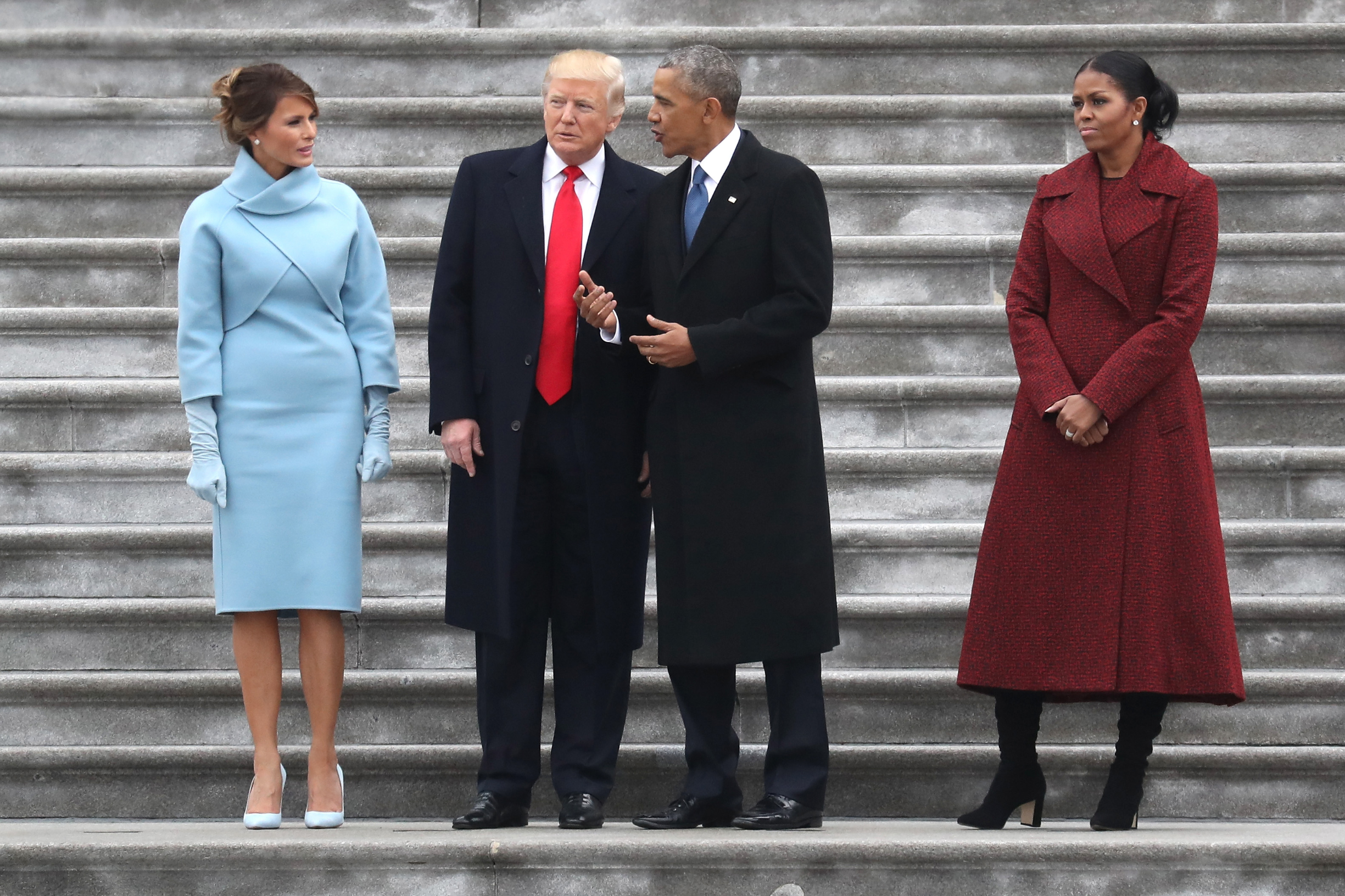 President Donald Trump and former president Barack Obama stand on the steps of the  U.S. Capitol with First Lady Melania Trump and Michelle Obamal on January 20, 2017 in Washington, DC. In today's inauguration ceremony Donald J. Trump becomes the 45th president of the United States.  REUTERS/Rob Carr/Pool - HT1ED1L02FS71