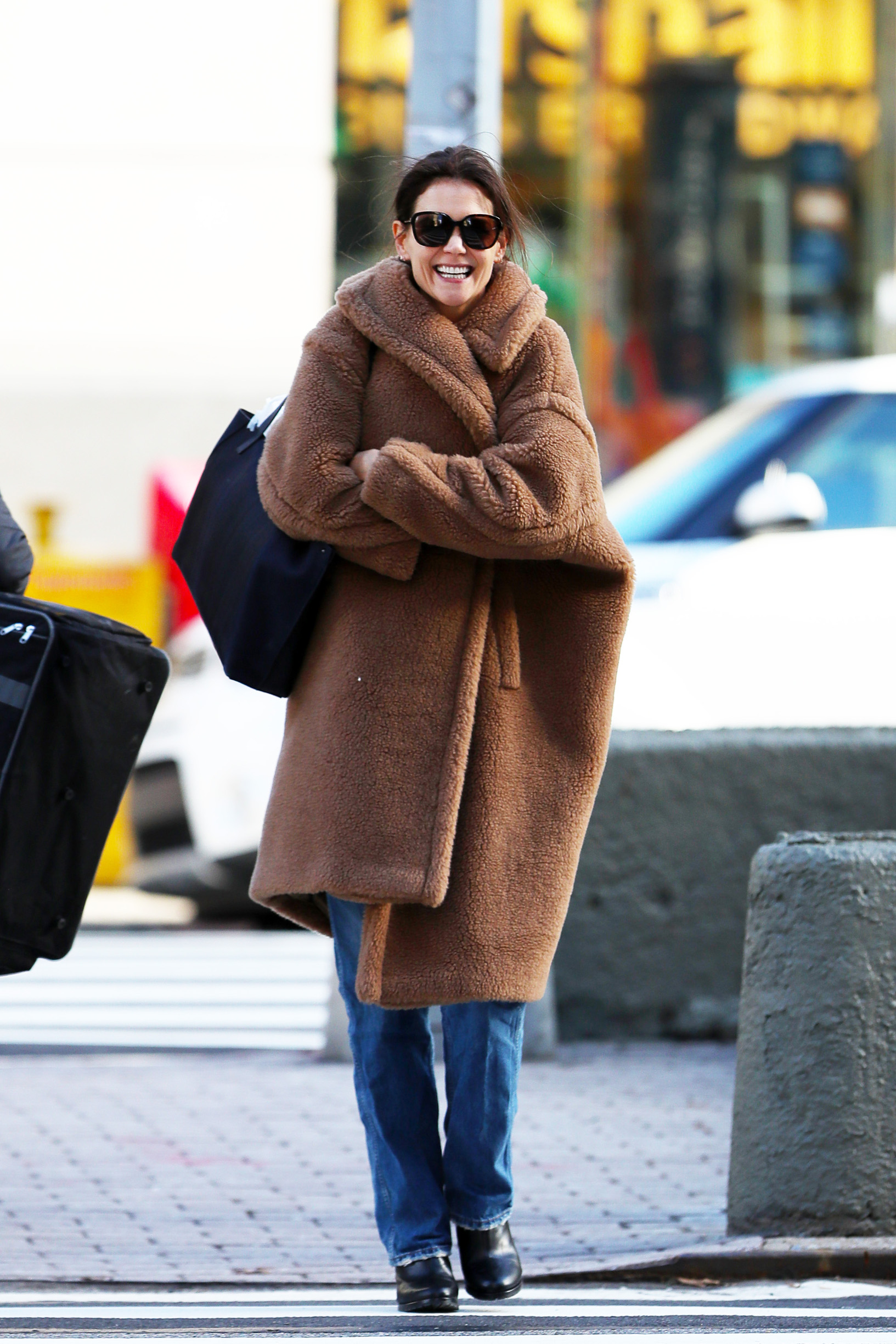12/15/2019 EXCLUSIVE: Katie Holmes flashes a big smile as bundles up while out on a stroll in New York City. The 40 year old actress wore an identical outfit as the previous day, a brown teddy coat, blue jeans, and black boots., Image: 488408542, License: Rights-managed, Restrictions: Exclusive NO usage without agreed price and terms. Please contact sales@theimagedirect.com, Model Release: no, Credit line: TheImageDirect.com / The Image Direct / Profimedia