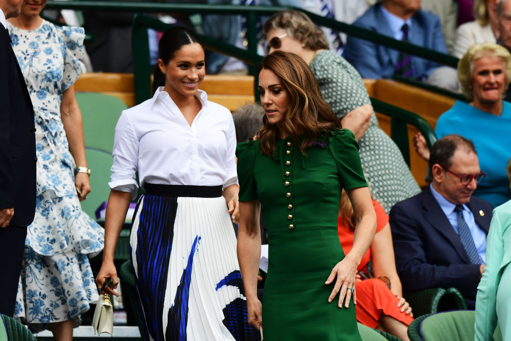 LONDON, ENGLAND - JULY 13: Catherine, Duchess of Cambridge and Meghan, Duchess of Sussex attend the Royal Box during Day twelve of The Championships - Wimbledon 2019 at All England Lawn Tennis and Croquet Club on July 13, 2019 in London, England. (Photo by Shaun Botterill/Getty Images)
