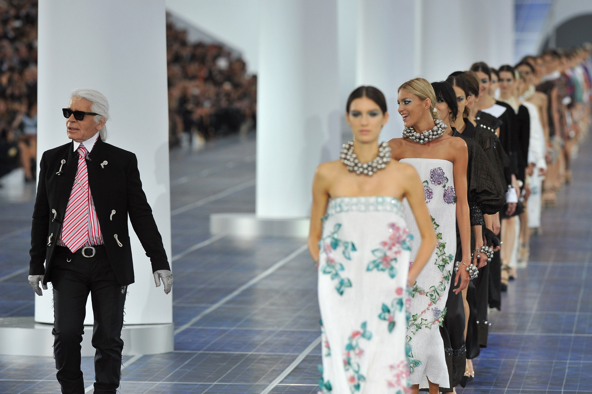 PARIS, FRANCE - OCTOBER 02: Karl Lagerfeld (L) walks the runway with the Chanel models during the Chanel Spring / Summer 2013 show as part of Paris Fashion Week at Grand Palais on October 2, 2012 in Paris, France.  (Photo by Pascal Le Segretain/Getty Images)