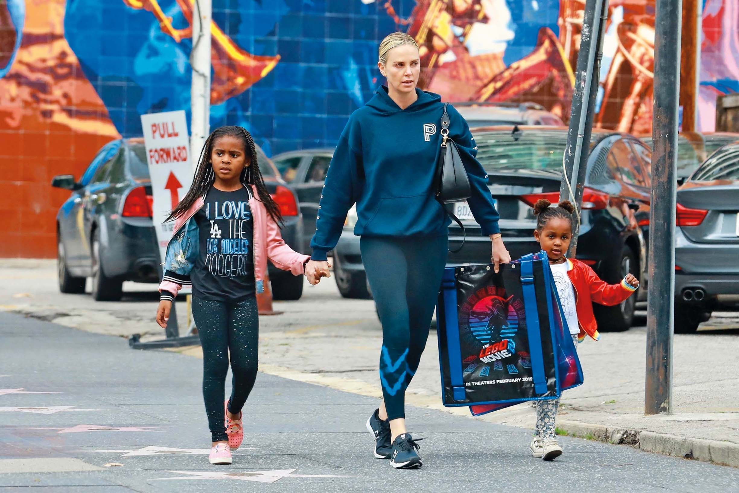 Hollywood, CA  - *EXCLUSIVE*  - Actress, Charlize Theron, is joined by her kids, Jackson and August Theron, for a trip to the premiere of the Lego Movie 2 in Los Angeles. The family step out in casual wear sporting hoodies, bomber jackets, and sneakers.  Pictured: Charlize Theron, August Theron, Jackson Theron     *UK Clients - Pictures Containing Children Please Pixelate Face Prior To Publication*, Image: 411719601, License: Rights-managed, Restrictions: , Model Release: no, Credit line: SL, Terma / BACKGRID / Backgrid USA / Profimedia