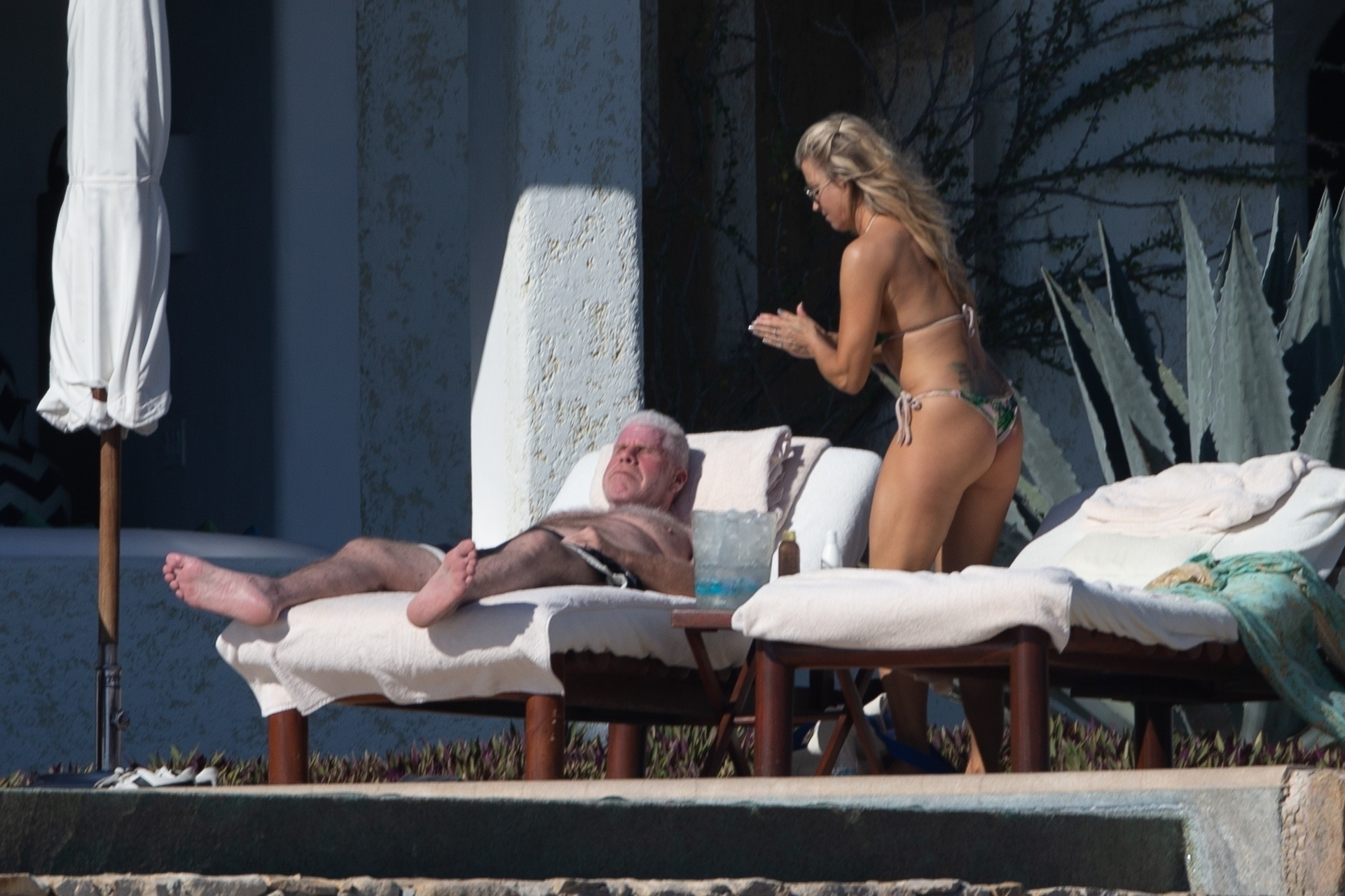 Cabo San Lucas, MEXICO  - *PREMIUM-EXCLUSIVE*  -  *Web Embargo until 4pm PST on December 17, 2019* Actor Ron Perlman is spotted kicking back in Mexico with new girlfriend Allison Dunbar just weeks after filing for divorce from his wife of 38 years. The 69 year old 'Hellboy' star was seen kicking back on a beach lounger as Allison rubbed him down with sunscreen. Perlman filed for divorce  in early November just 5 months after he was pictured kissing his 'StartUp' co-star outside of a steakhouse in Pasadena.  Dunbar put her amazing bikini body on display during their day out under the sun in a tropical print two piece. Perlman, smiling,  certainly seemed to take notice of how great she looked. *Shot on December 14, 2019*  BACKGRID USA 17 DECEMBER 2019, Image: 488614891, License: Rights-managed, Restrictions: , Model Release: no, Credit line: HEM / BACKGRID / Backgrid USA / Profimedia