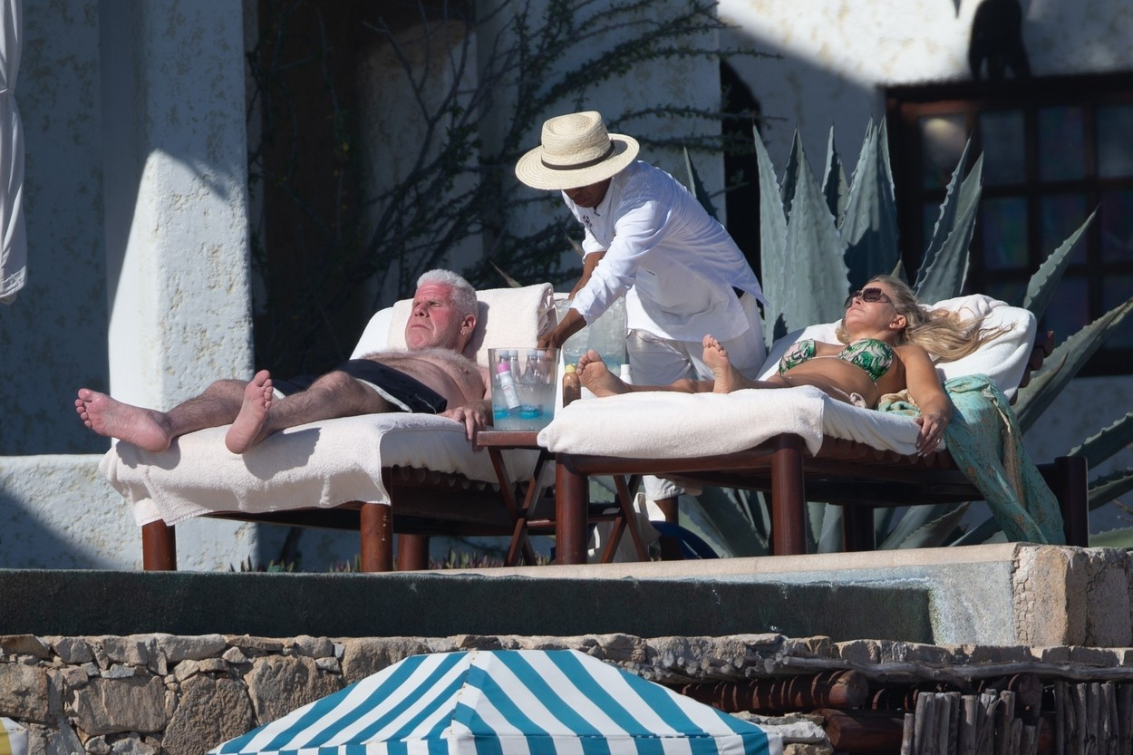 Cabo San Lucas, MEXICO  - *PREMIUM-EXCLUSIVE*  -  *Web Embargo until 4pm PST on December 17, 2019* Actor Ron Perlman is spotted kicking back in Mexico with new girlfriend Allison Dunbar just weeks after filing for divorce from his wife of 38 years. The 69 year old 'Hellboy' star was seen kicking back on a beach lounger as Allison rubbed him down with sunscreen. Perlman filed for divorce  in early November just 5 months after he was pictured kissing his 'StartUp' co-star outside of a steakhouse in Pasadena.  Dunbar put her amazing bikini body on display during their day out under the sun in a tropical print two piece. Perlman, smiling,  certainly seemed to take notice of how great she looked. *Shot on December 14, 2019*  BACKGRID USA 17 DECEMBER 2019, Image: 488614982, License: Rights-managed, Restrictions: , Model Release: no, Credit line: HEM / BACKGRID / Backgrid USA / Profimedia