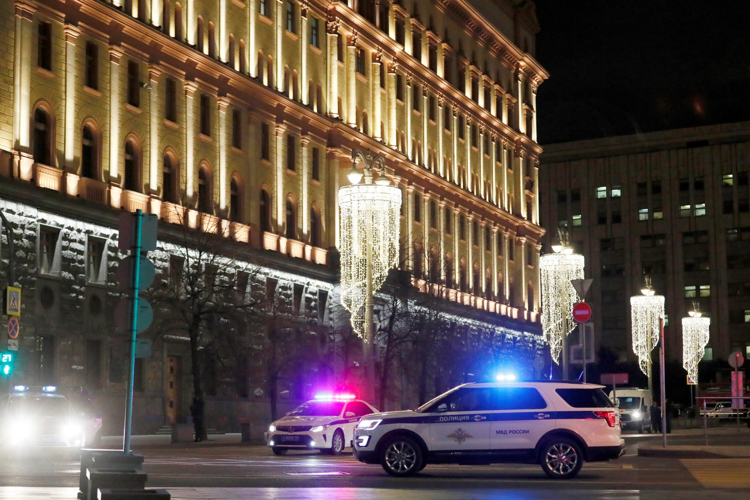 Police vehicles block a street near the Federal Security Service (FSB) building after a shooting incident, in Moscow, Russia December 19, 2019. REUTERS/Shamil Zhumatov