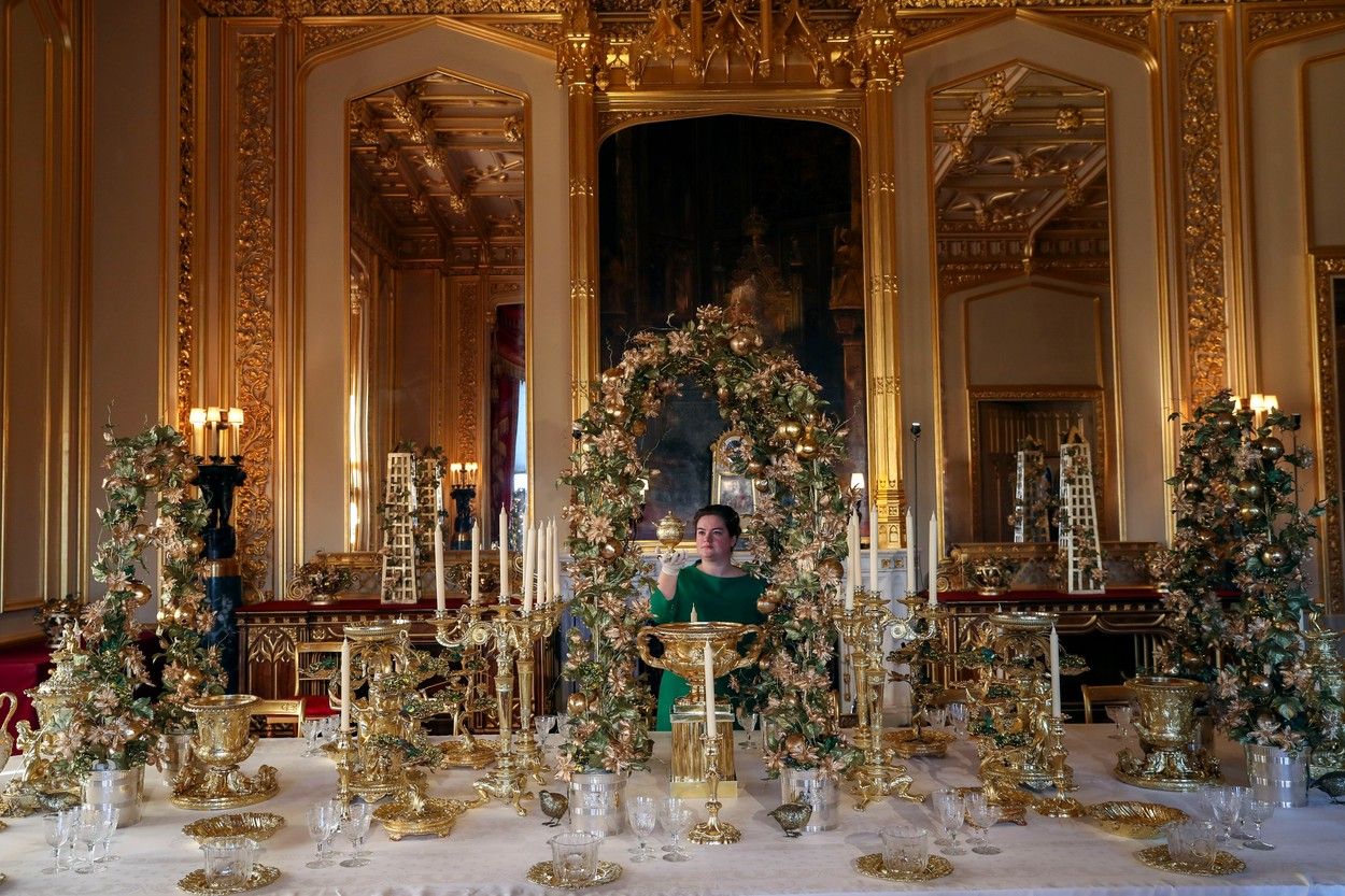 A Royal Collection Trust member of staff puts the finishing touches to the Grand Service in the State Dinning Room at Windsor Castle, Berkshire., Image: 485469565, License: Rights-managed, Restrictions: , Model Release: no, Credit line: Steve Parsons / PA Images / Profimedia