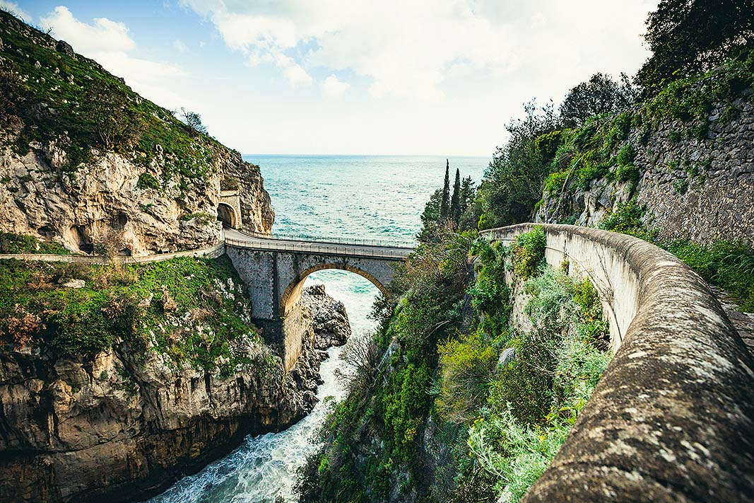 famous bridge of furore at the amalfi coastline in italy.