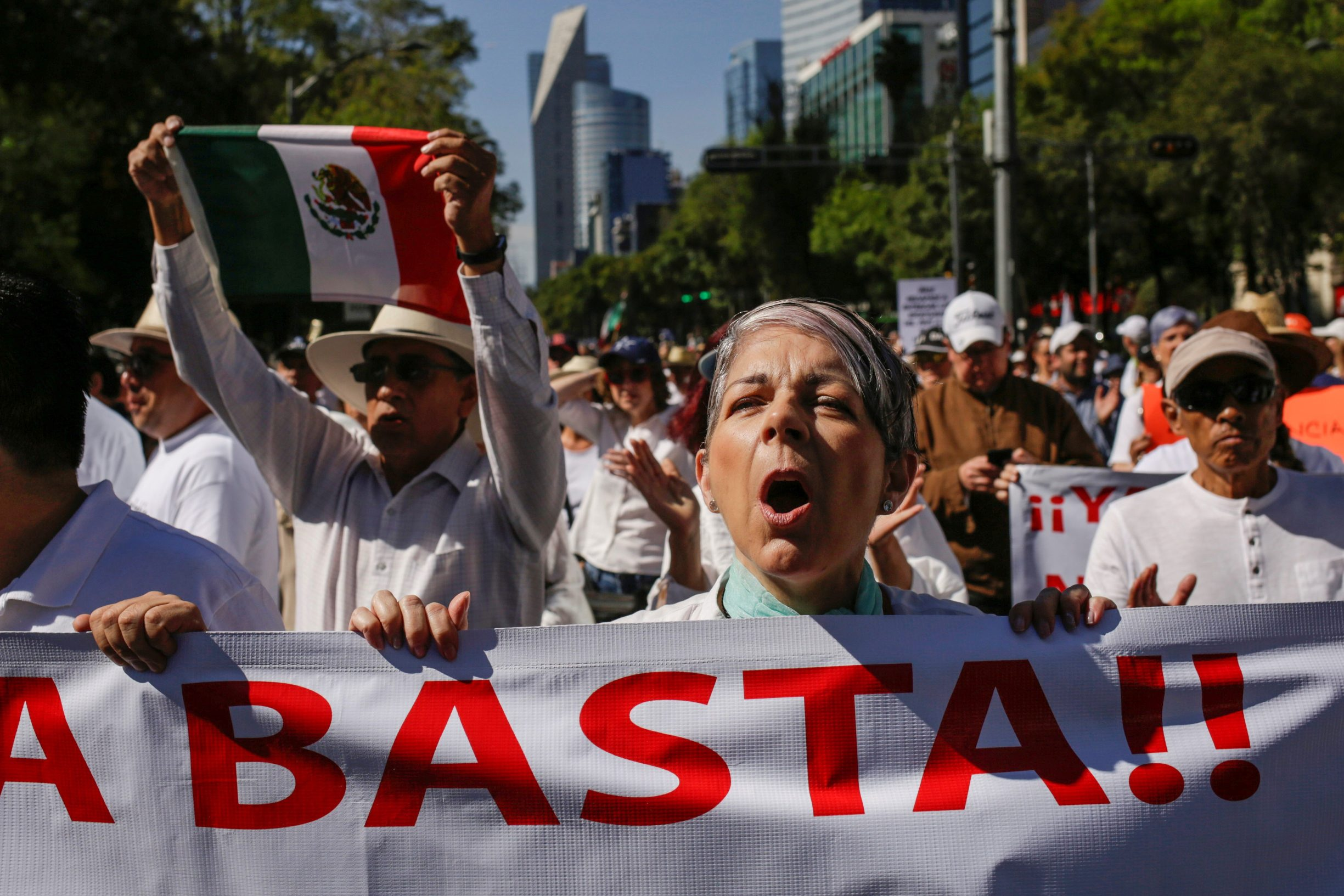 Demonstrators hold up signs during a march to protest against violence on the first anniversary of President Andres Manuel Lopez Obrador taking office, in Mexico City, Mexico December 1, 2019. Signs read: