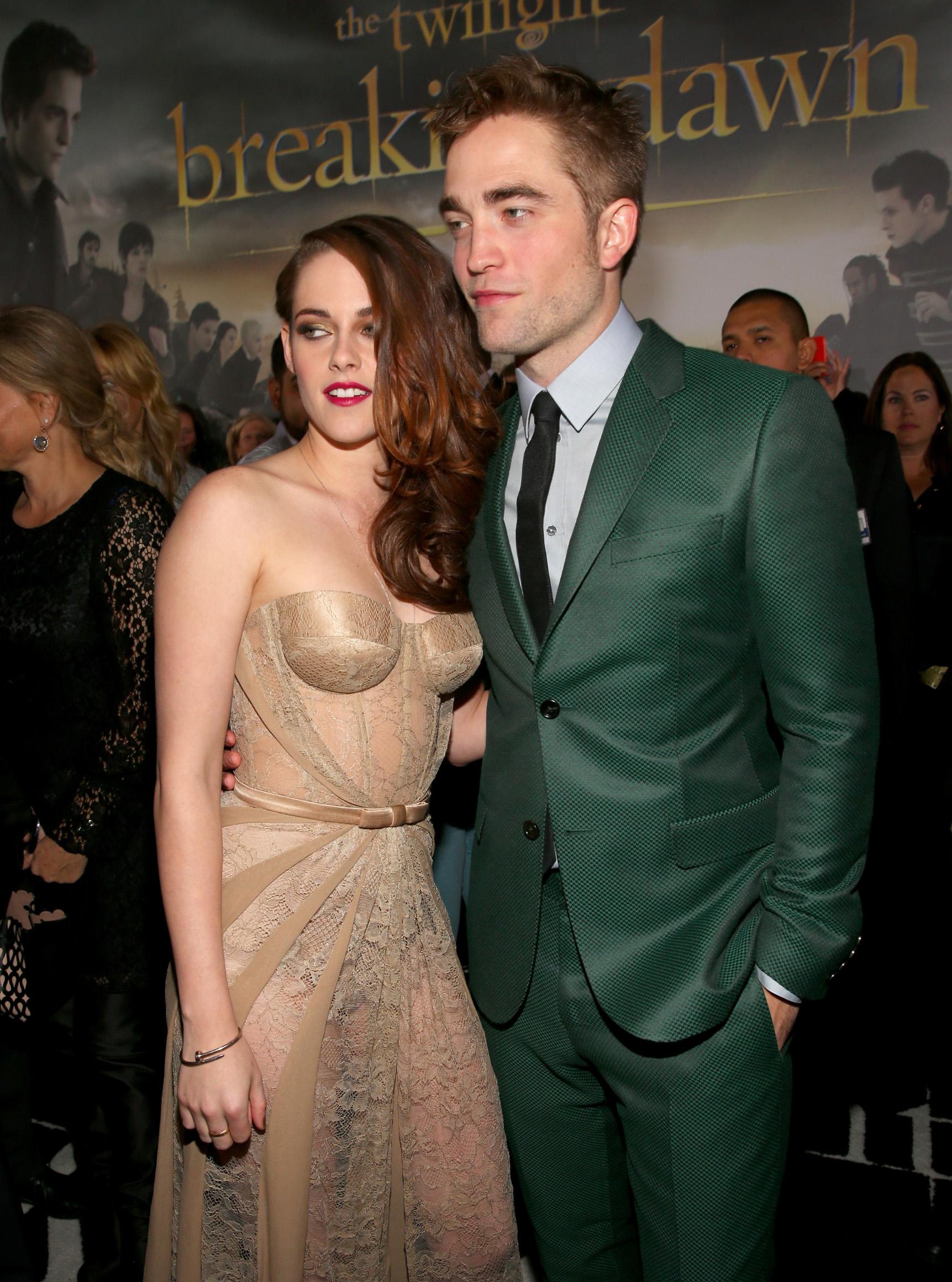 LOS ANGELES, CA - NOVEMBER 12:  Actors Kristen Stewart (L) and Robert Pattinson arrive at the premiere of Summit Entertainment's
