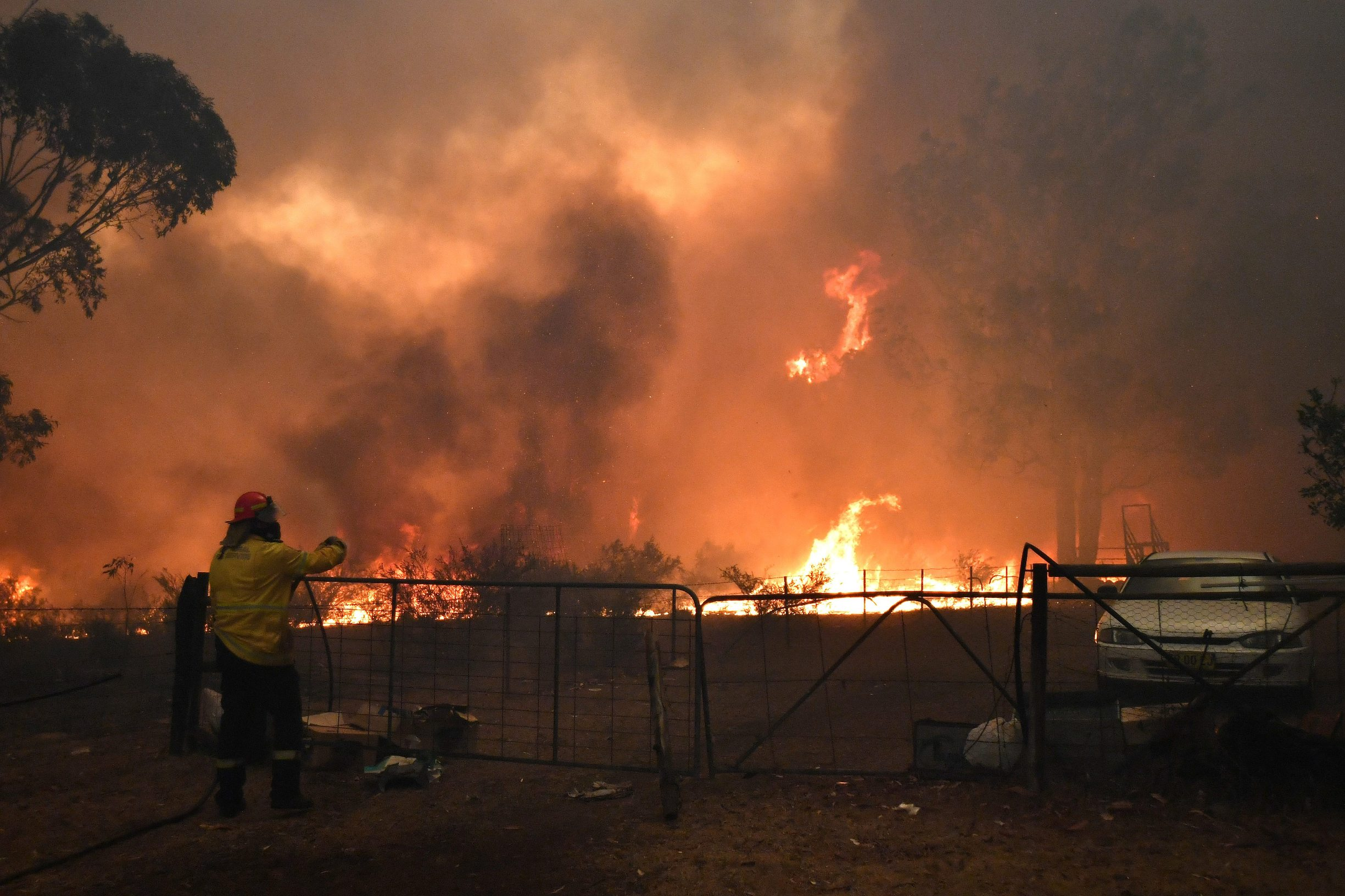 Rural Fire Service (RFS) crews engage in property protection of a number of homes along the Old Hume Highway near the town of Tahmoor as the Green Wattle Creek Fire threatens a number of communities in the southwest of Sydney, Australia, December 19, 2019. AAP Image/Dean Lewins/via REUTERS ATTENTION EDITORS - THIS IMAGE HAS BEEN SUPPLIED BY A THIRD PARTY. NO RESALES. NO ARCHIVES. AUSTRALIA OUT. NEW ZEALAND OUT.