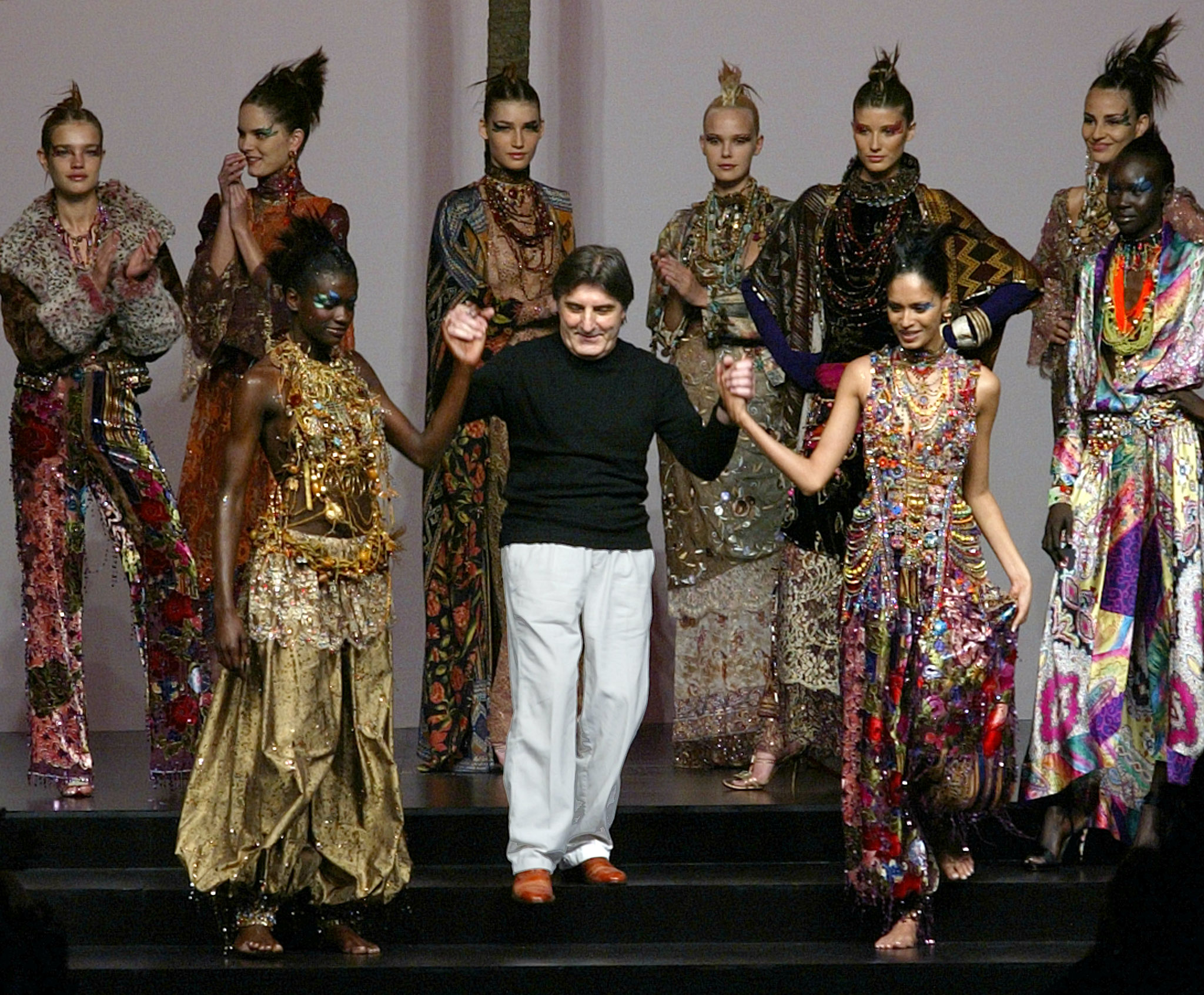 French designer Emanuel Ungaro appears with his models at the end of his Autumn-Winter 2002-2003 high fashion collection in Paris July 10, 2002. The Paris fashion collections run through July 11. REUTERS/Philippe Wojazer  MAL/ - RP3DRHXQWTAC