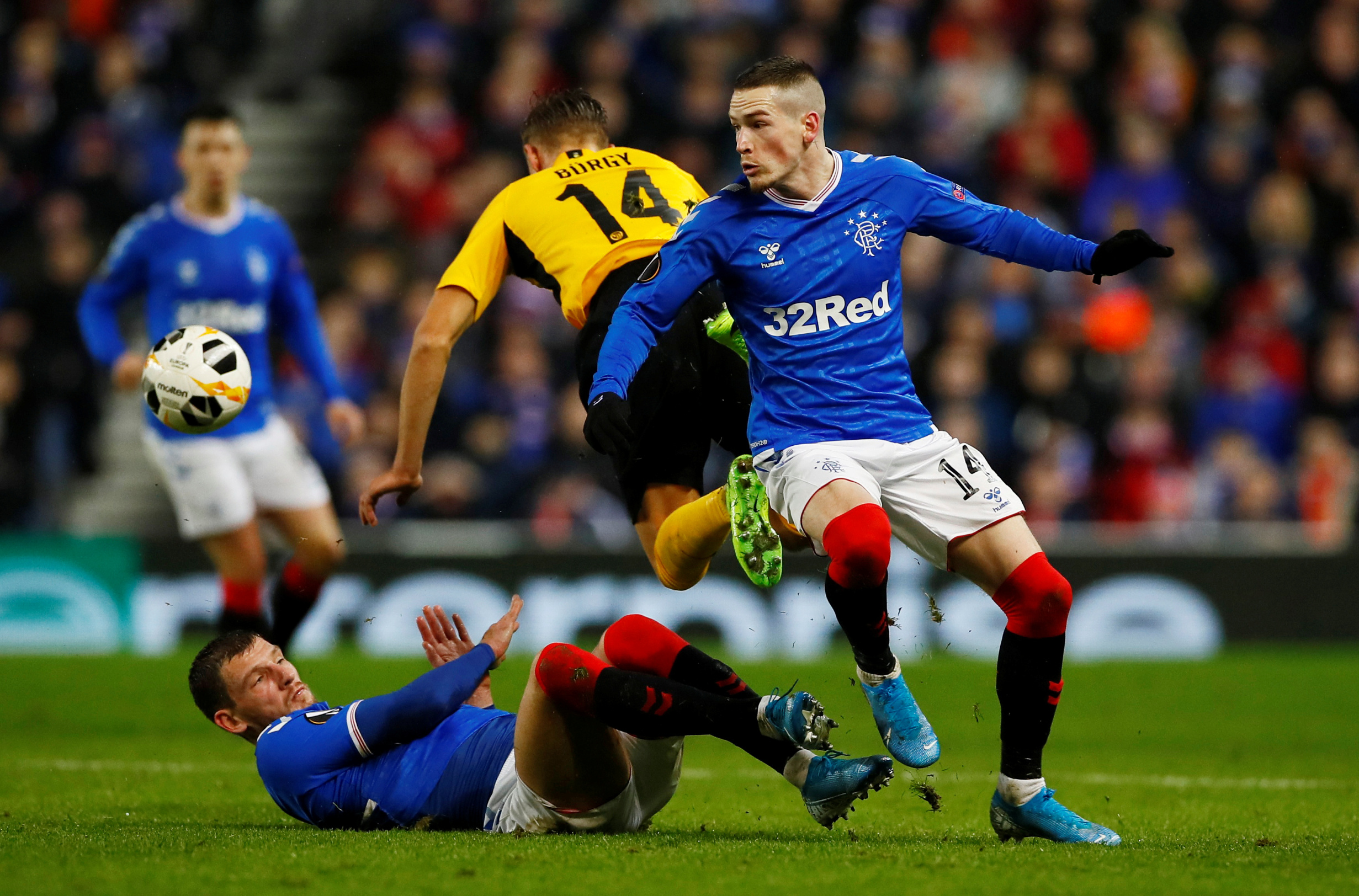 Soccer Football - Europa League - Group G - Rangers v BSC Young Boys - Ibrox, Glasgow, Scotland, Britain - December 12, 2019  Rangers' Ryan Kent and Borna Barisic in action with Young Boys' Nicolas Burgy   Action Images via Reuters/Jason Cairnduff