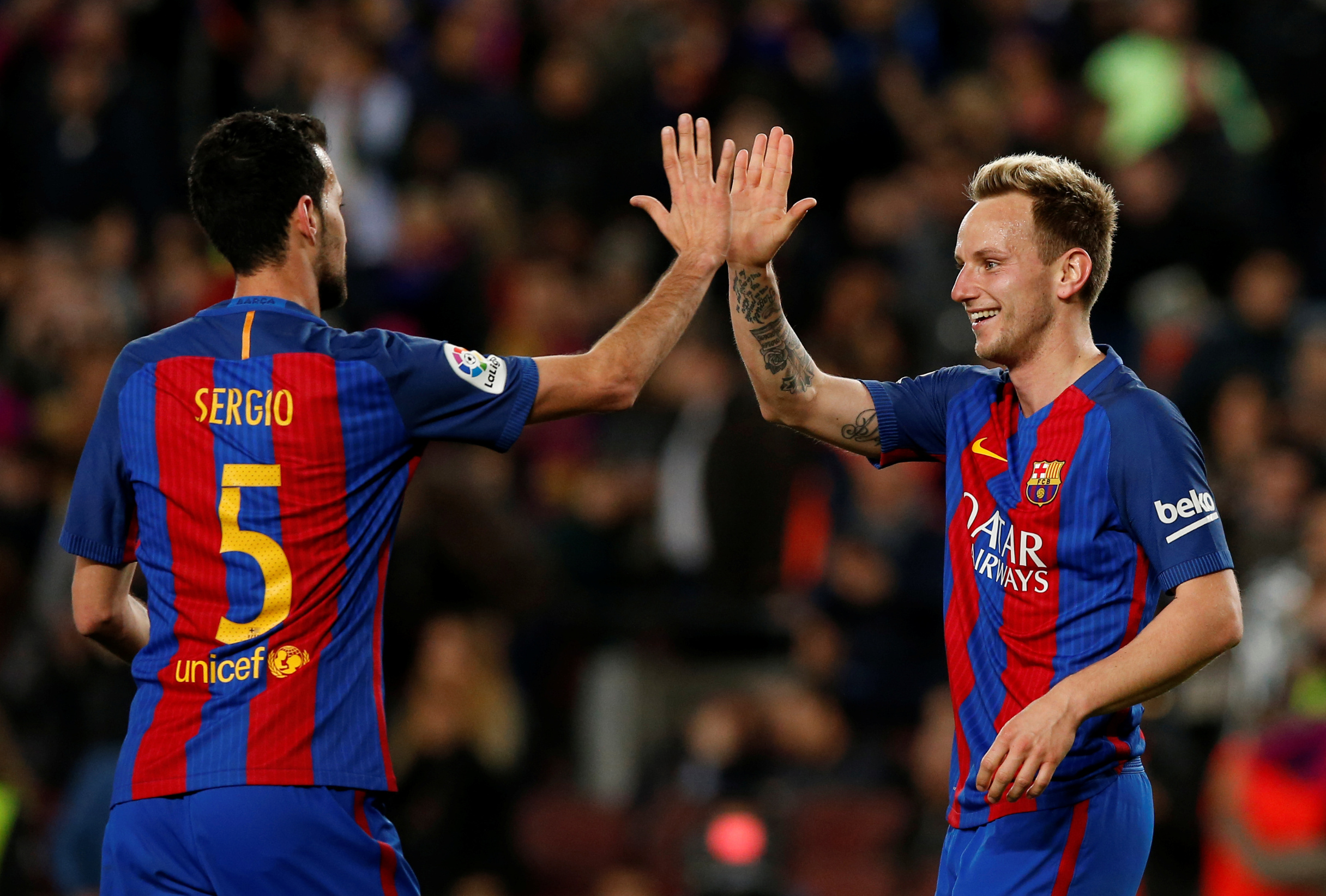 Football Soccer - Barcelona v Celta Vigo - Spanish La Liga Santander - Camp Nou stadium, Barcelona, Spain - 4/03/2017. Barcelona's Ivan Rakitic and Sergio Busquets celebrate a goal. REUTERS/Albert Gea - RC1D213FFD70