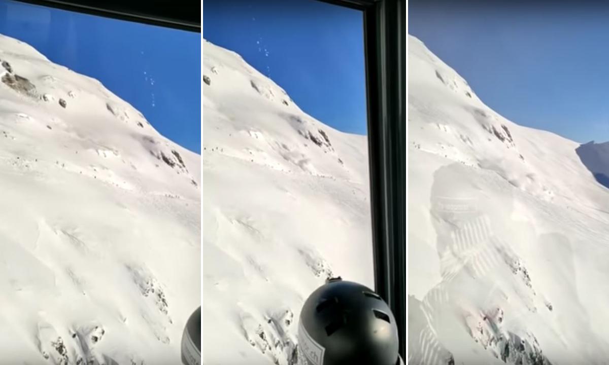 Screenshot snimke iz žičare - u sredini skijaši na koje se ruši lavina