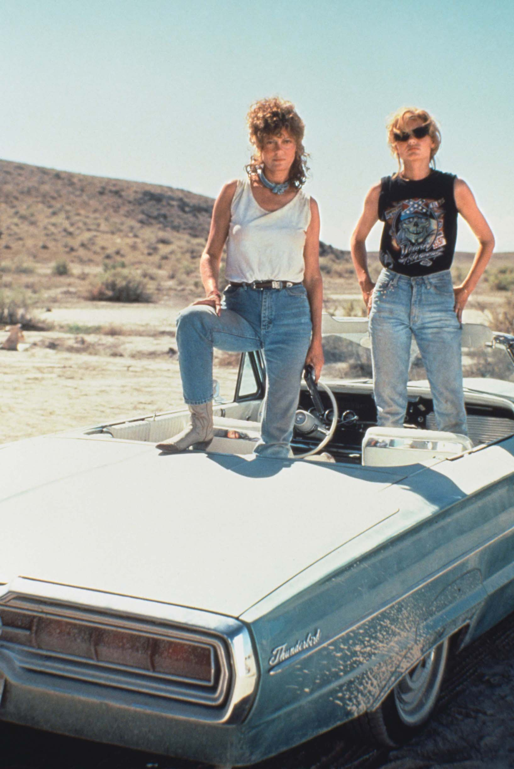 Actresses Susan Sarandon (left) and Geena Davis pose on their 1966 Ford Thunderbird, for the film 'Thelma And Louise', 1991. (Photo by Fotos International/Getty Images)