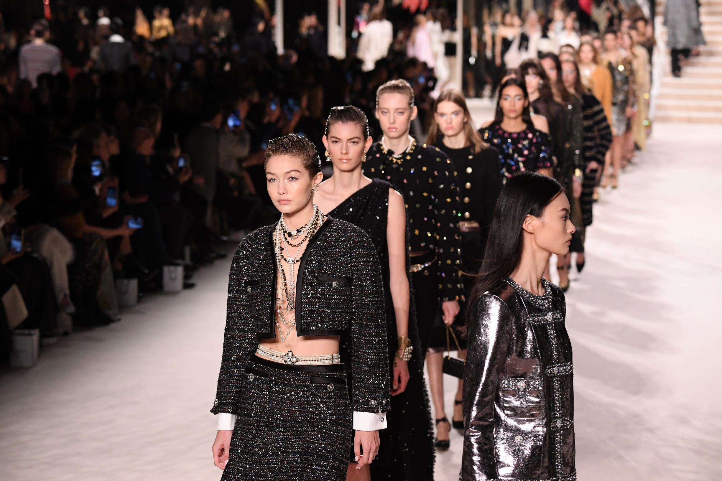 PARIS, FRANCE - DECEMBER 04: Models and Gigi Hadid walk the runway during the Chanel Metiers d'art 2019-2020 show at Le Grand Palais on December 04, 2019 in Paris, France. (Photo by Pascal Le Segretain/Getty Images)