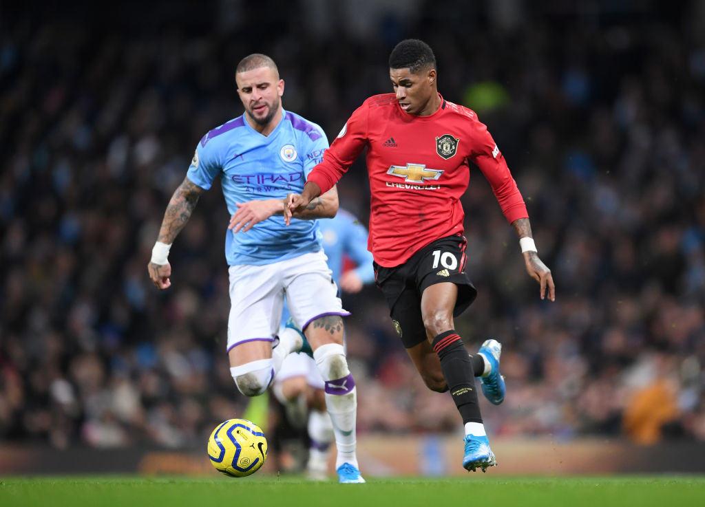 MANCHESTER, ENGLAND - DECEMBER 07: Kyle Walker of Manchester City chases down Marcus Rashford of Manchester United during the Premier League match between Manchester City and Manchester United at Etihad Stadium on December 07, 2019 in Manchester, United Kingdom. (Photo by Laurence Griffiths/Getty Images)