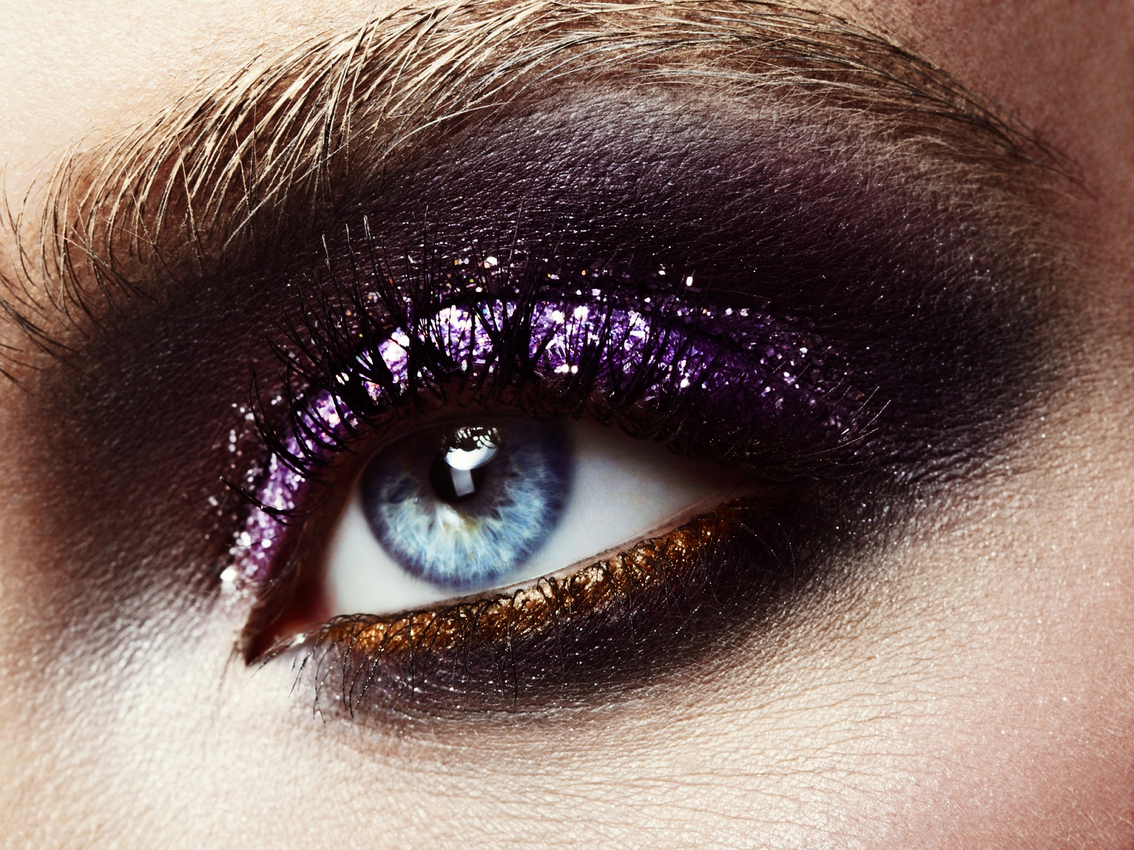 Female eye with professional bright shiny make-up.