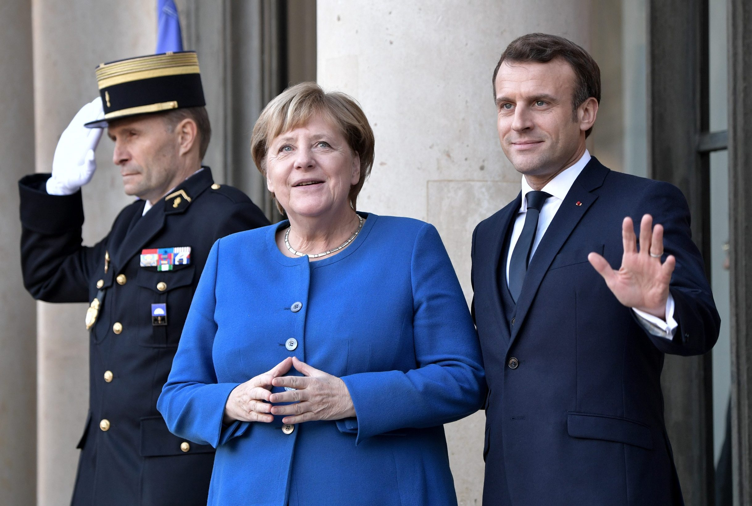 German Chancellor Angela Merkel and French President Emmanuel Macron pose for a picture during their meeting ahead of a Normandy-format summit in Paris, France December 9, 2019. Sputnik/Alexey Nikolsky/Kremlin via REUTERS ATTENTION EDITORS - THIS IMAGE WAS PROVIDED BY A THIRD PARTY.