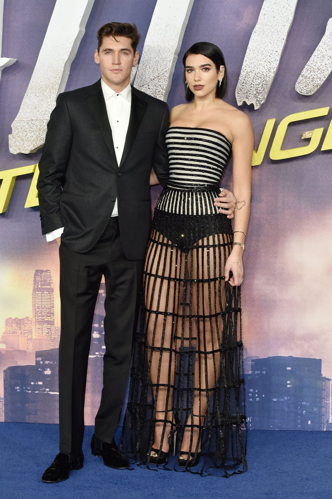 BGUK_1473751 - London, UNITED KINGDOM  - Dua Lipa and Isaac Carew attends the Alita: Battle Angel World Premiere at Odeon Leicester Square. London.  Pictured: Dua Lipa, Isaac Carew  BACKGRID UK 31 JANUARY 2019, Image: 411508523, License: Rights-managed, Restrictions: , Model Release: no, Credit line: Profimedia, Backgrid UK