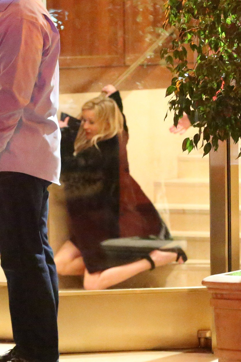 Reese Witherspoon takes a spill as she leaves the Sunset Tower Hotel after attending Jennifer Aniston's 50th birthday party in West Hollywood. Reese appears to have had a real good time at Jennifer's 50th birthday bash as she is seen tripping down the stairs on her way out. 10 Feb 2019, Image: 413044016, License: Rights-managed, Restrictions: World Rights, Model Release: no, Credit line: Profimedia, Mega Agency
