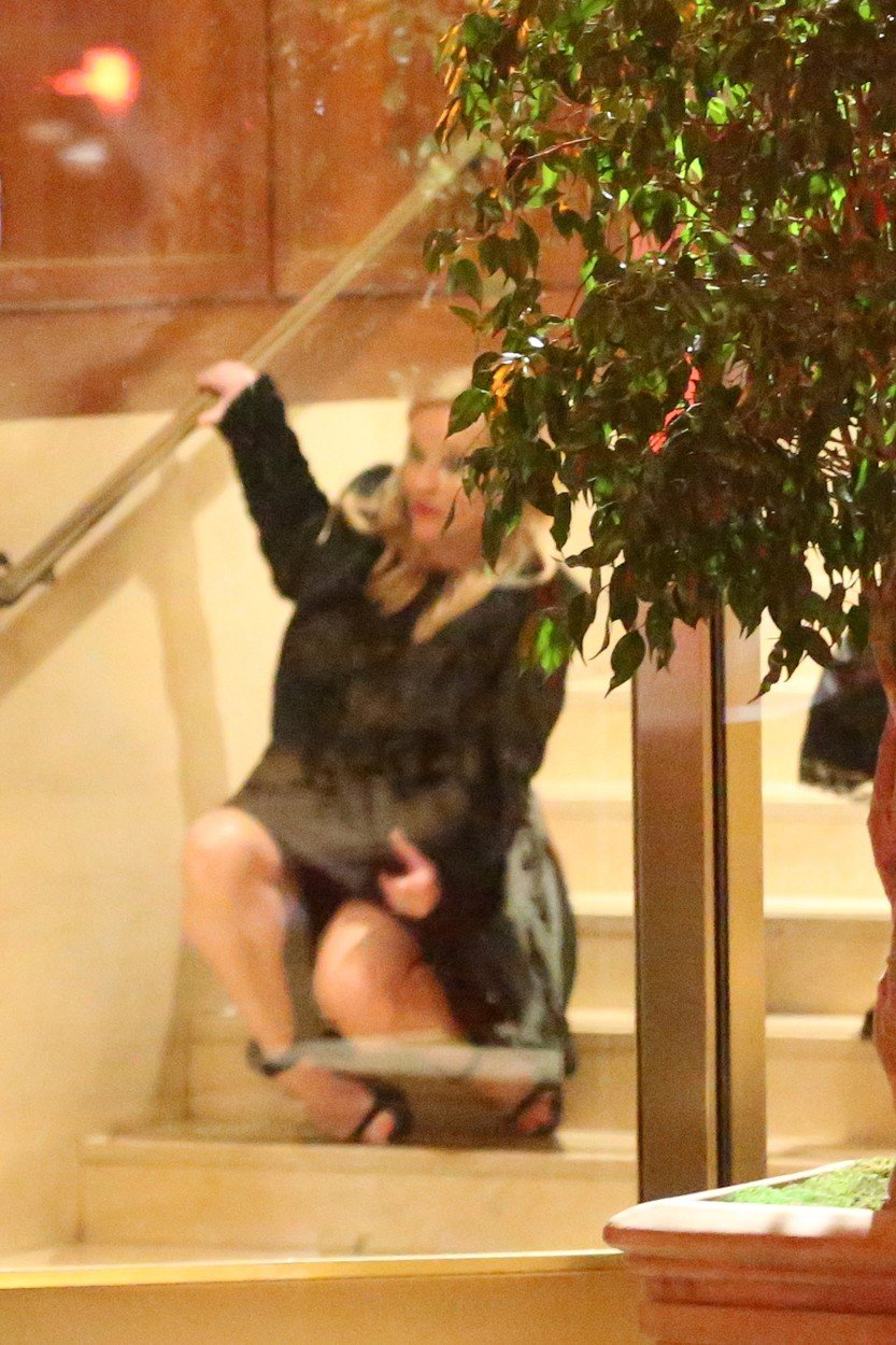 Reese Witherspoon takes a spill as she leaves the Sunset Tower Hotel after attending Jennifer Aniston's 50th birthday party in West Hollywood. Reese appears to have had a real good time at Jennifer's 50th birthday bash as she is seen tripping down the stairs on her way out. 10 Feb 2019, Image: 413044026, License: Rights-managed, Restrictions: World Rights, Model Release: no, Credit line: Profimedia, Mega Agency
