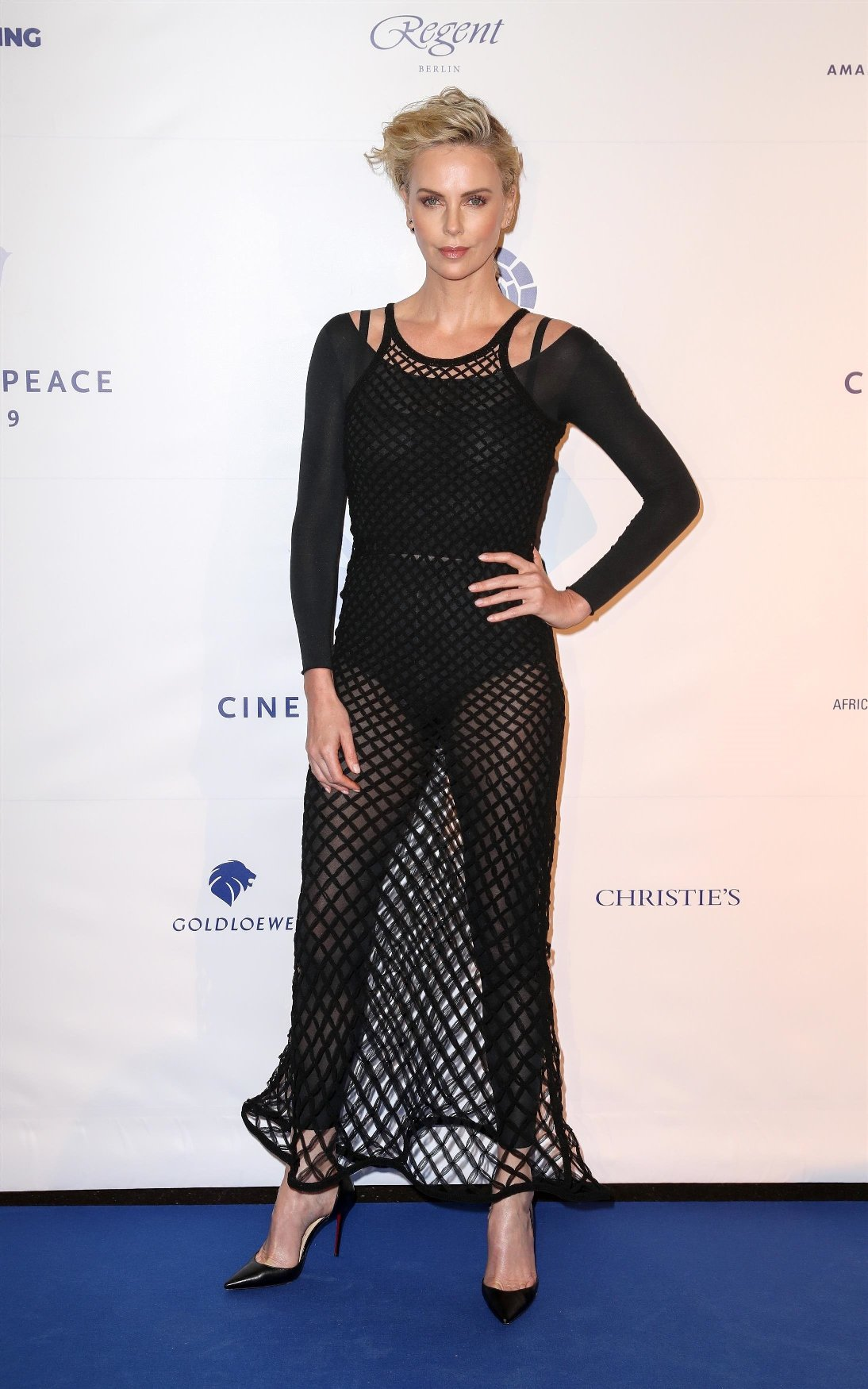 Berlin, GERMANY  - 10 February 2019, Berlin: Charlize Theron comes as a guest to Cinema for Peace at the China Club. Photo: Gerald Matzka/dpa-Zentralbild/ZB /MediaPunch ***FOR USA ONLY***  Pictured: Arts  BACKGRID USA 9 FEBRUARY 2019, Image: 413113518, License: Rights-managed, Restrictions: , Model Release: no, Credit line: Profimedia, Backgrid USA