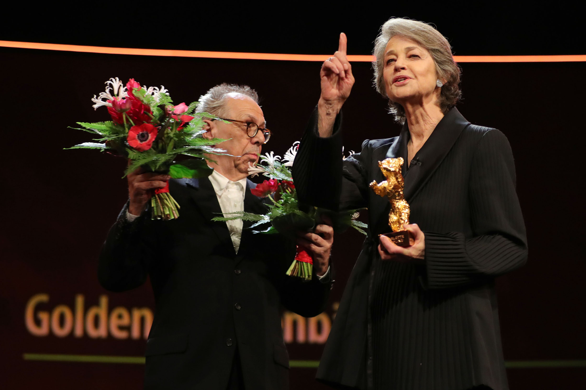 BERLIN, GERMANY - FEBRUARY 14: Charlotte Rampling (R) receives the Golden Bear from Festival director Dieter Kosslick (L) on stage at the Homage Charlotte Rampling Honorary Golden Bear award ceremony during the 69th Berlinale International Film Festival Berlin at Berlinale Palace on February 14, 2019 in Berlin, Germany. Rampling is this years recipient of the Honorary Golden Bear Award of the Berlinale. (Photo by Andreas Rentz/Getty Images)