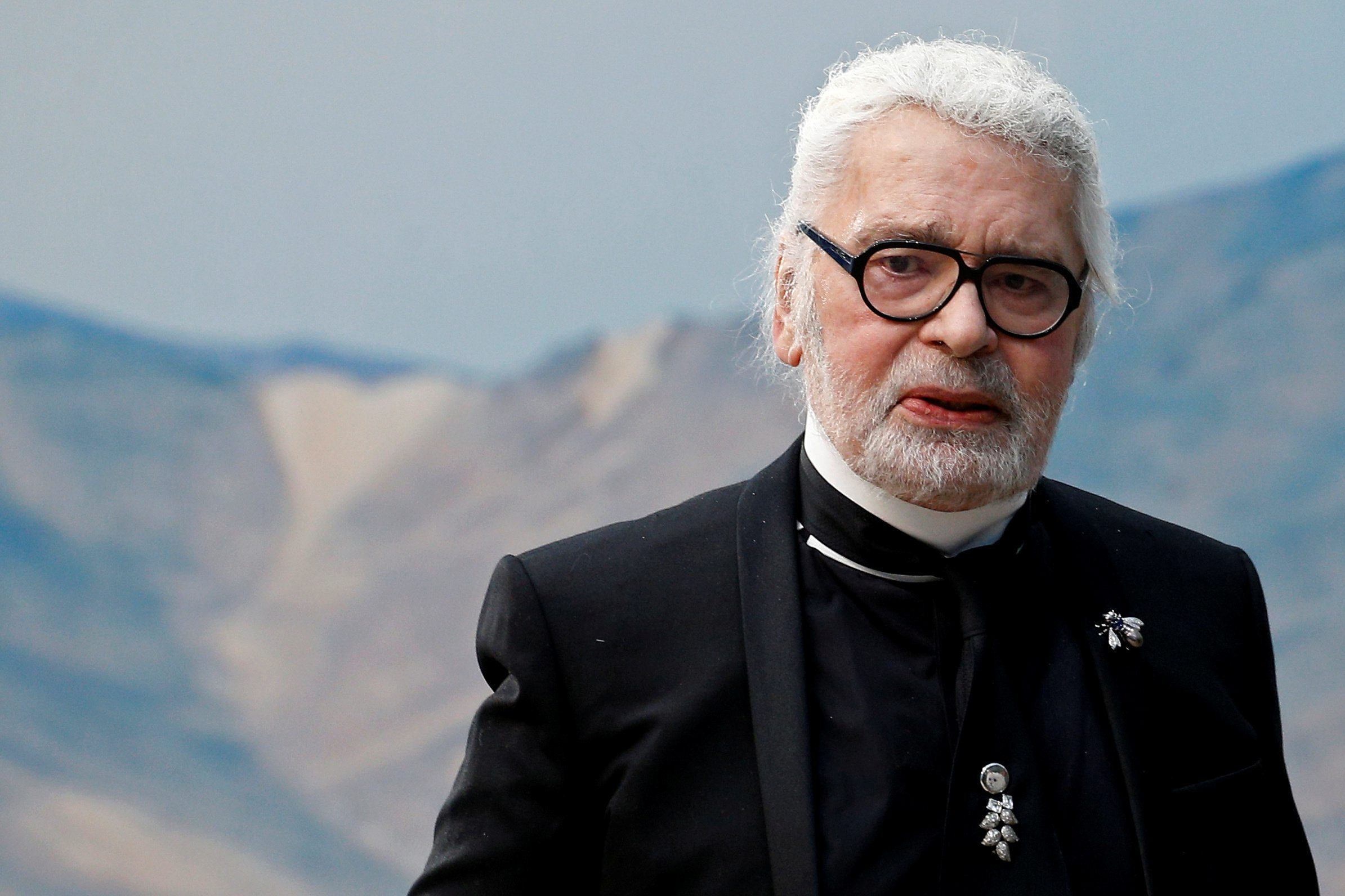 FILE PHOTO: German designer Karl Lagerfeld appears at the end of his Spring/Summer 2019 women's ready-to-wear collection show for fashion house Chanel during Paris Fashion Week in Paris, France, October 2, 2018. REUTERS/Stephane Mahe/File Photo