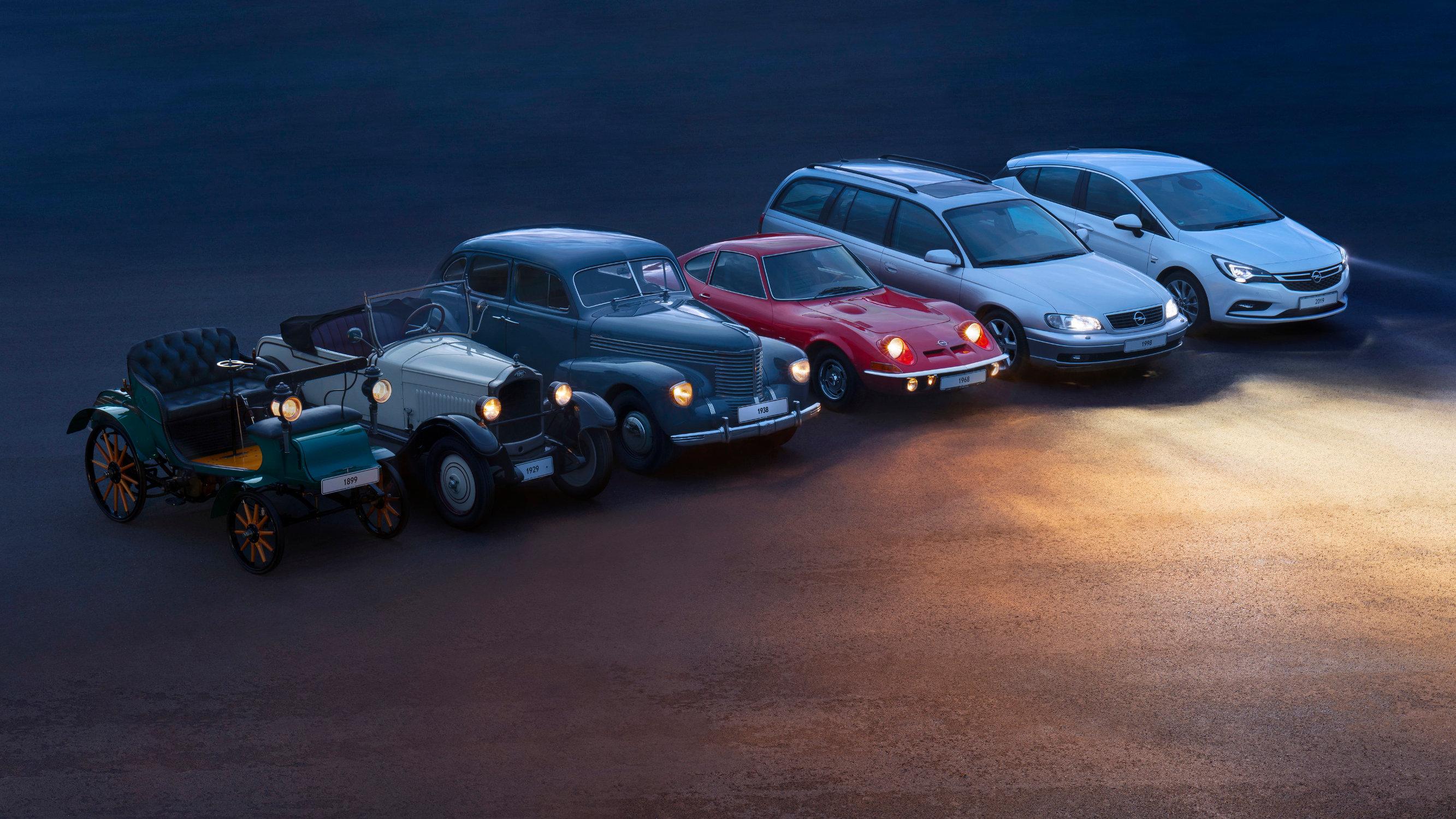 1899 Opel Patentmotorwagen System Lutzmann - 1929 Opel 4/20 PS Luxus-Zweisitzer - 1938 Opel Kapitän - 1998 Opel Omega Caravan - 2019 Opel Astra with IntelliLux LED Matrix-Licht