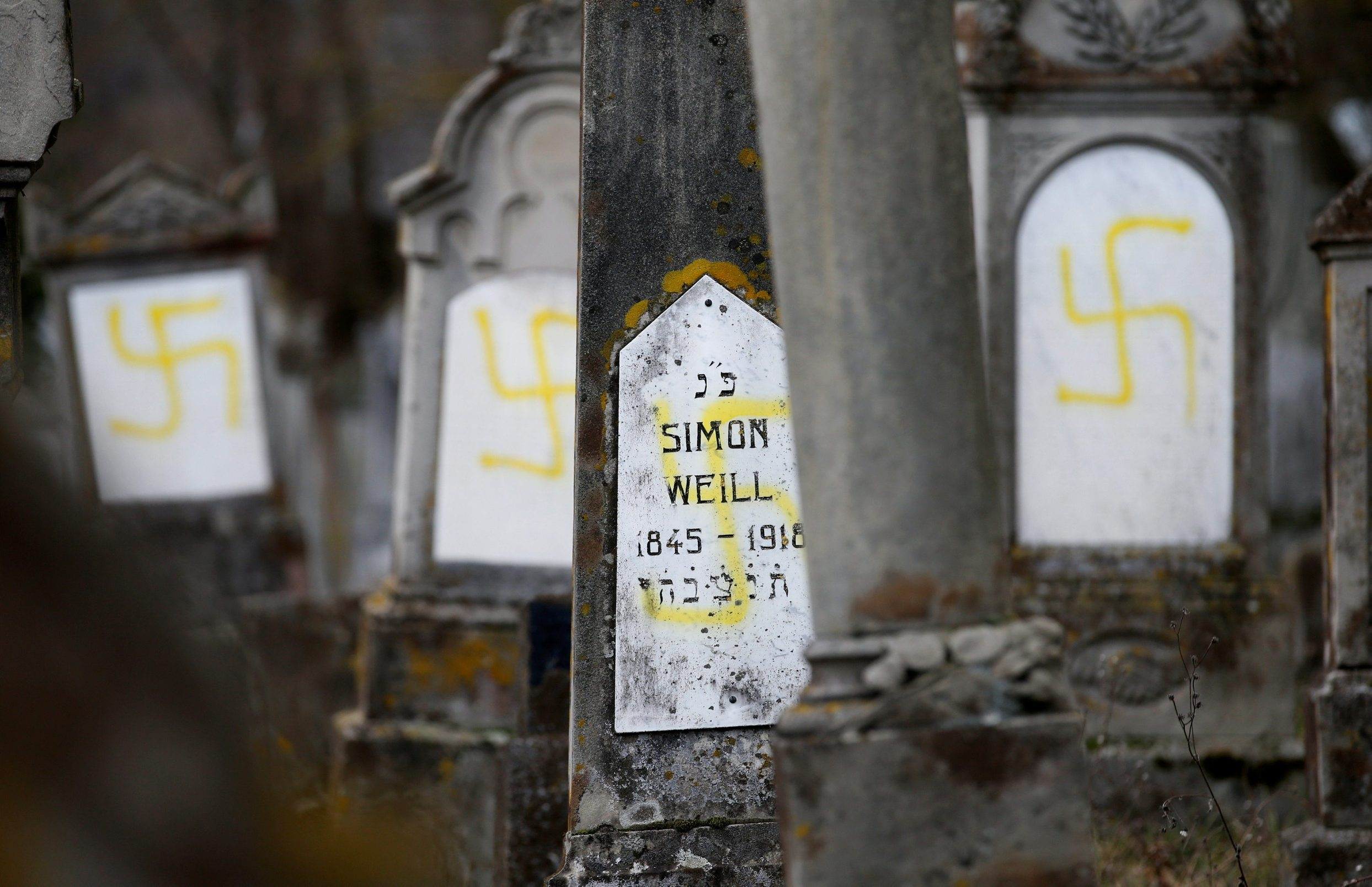Graves that were desecrated with swastikas are seen at the Jewish cemetery in Quatzenheim, near Strasbourg, France, February 19, 2019. REUTERS/Vincent Kessler      TPX IMAGES OF THE DAY