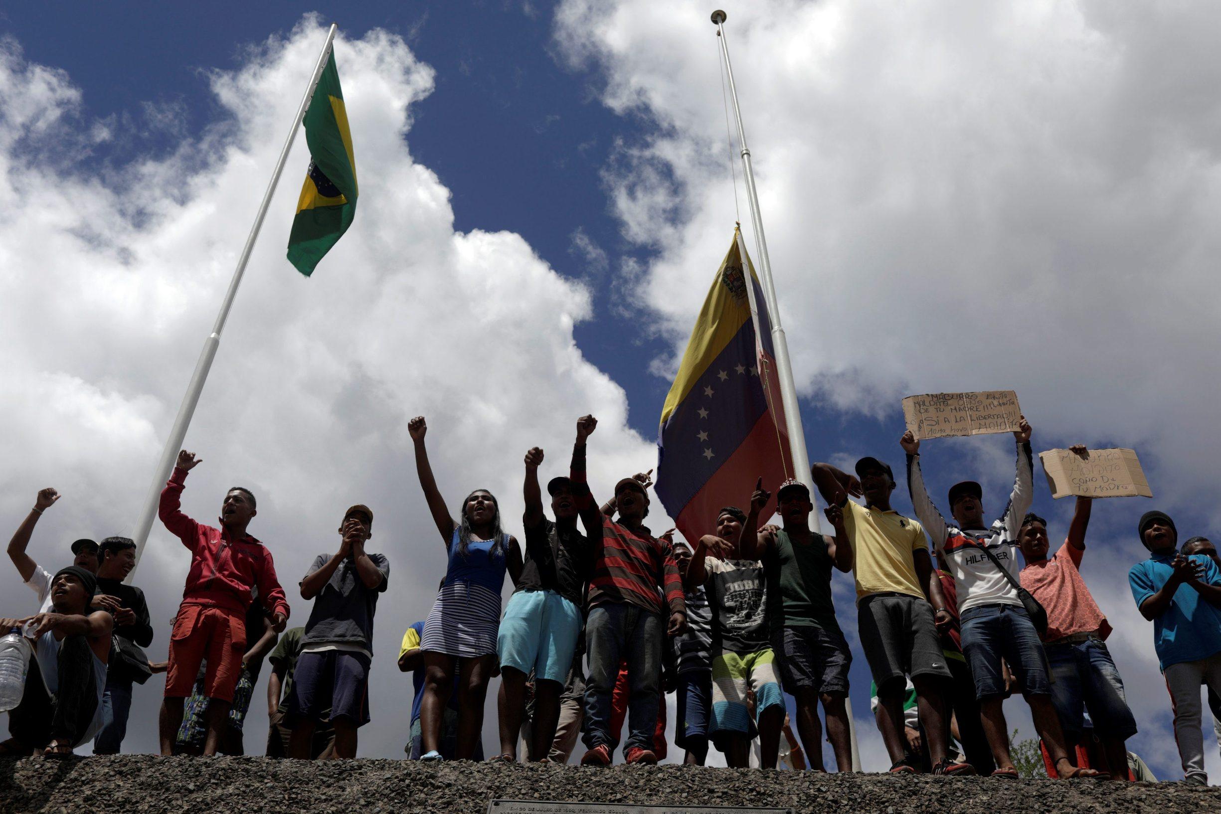 People waiting to cross to Venezuela gesture at the border between Venezuela and Brazil in Pacaraima, Roraima state, Brazil, February 22, 2019. REUTERS/Ricardo Moraes