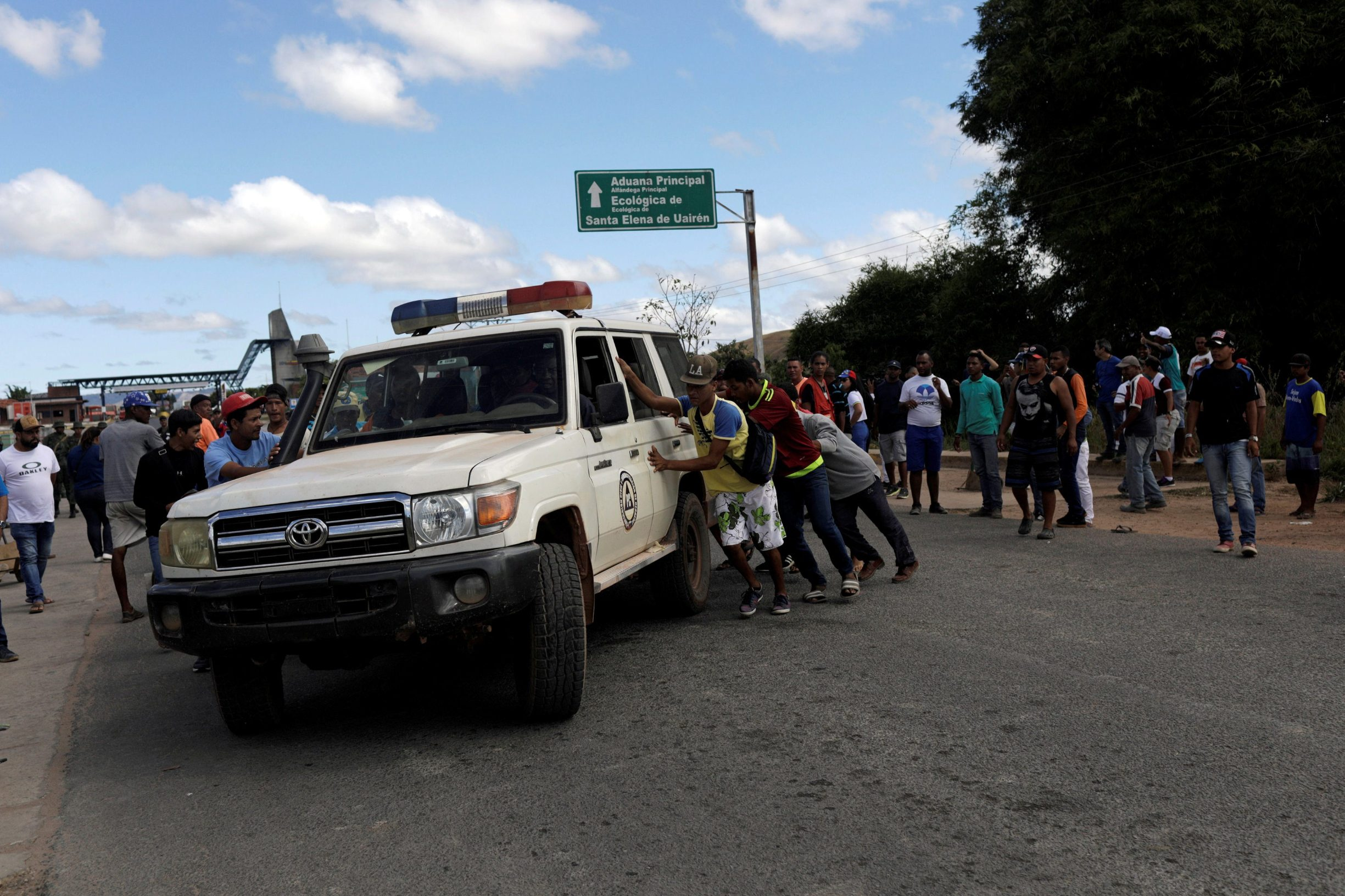 REFILE - CORRECTING LOCATION  An ambulance carrying people that were injured during clashes in the southern Venezuelan town of Kumarakapay, near the border with Brazil, is assisted by people at the border between Venezuela and Brazil, in Pacaraima, Roraima state, Brazil February 22, 2019. REUTERS/Ricardo Moraes