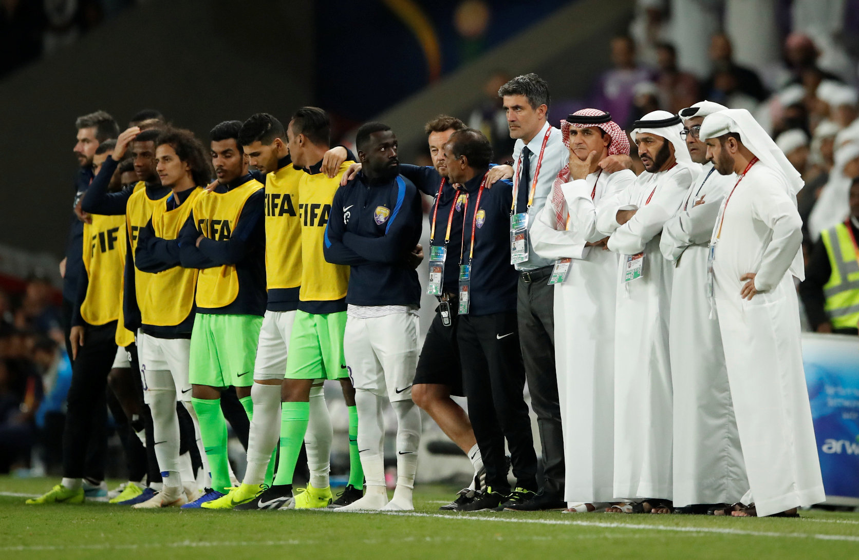 Soccer Football - Club World Cup - Semi-Final - River Plate v Al Ain FC - Hazza Bin Zayed Stadium, Al Ain City, United Arab Emirates - December 18, 2018  Al-Ain coach Zoran Mamic with players and backroom staff during the penalty shootout                  REUTERS/Andrew Boyers