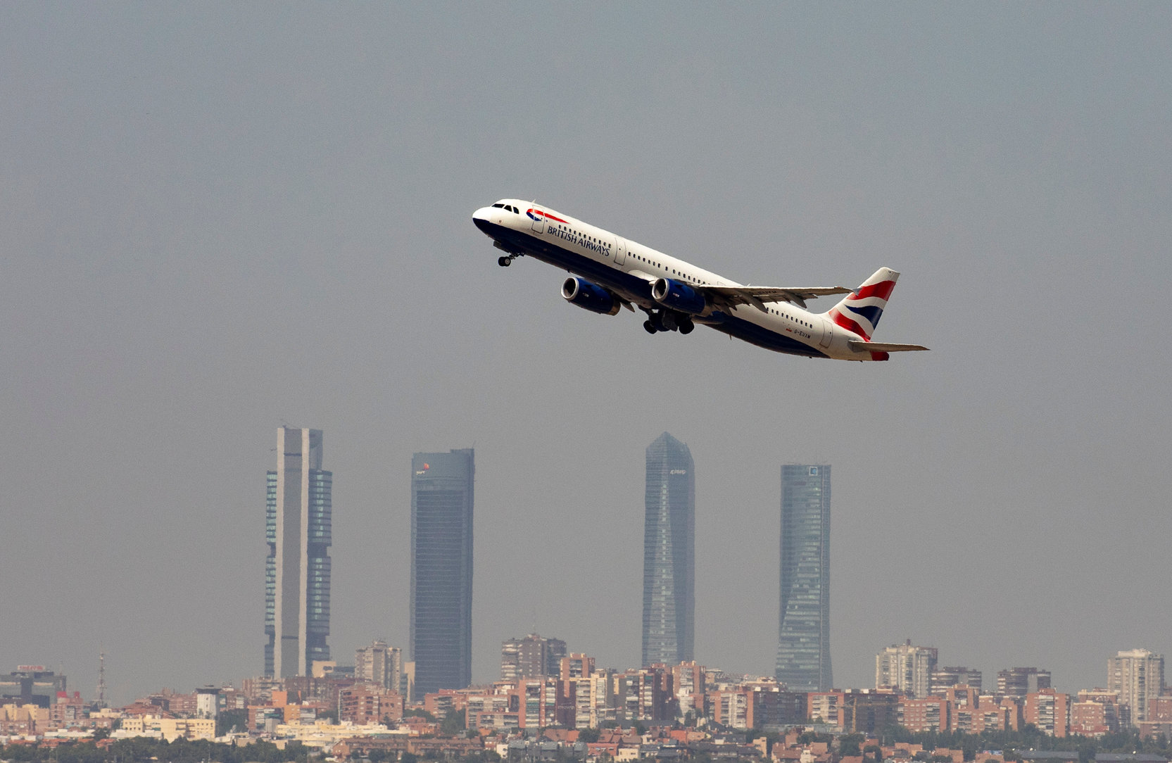 A British Airways Airbus A321-200 airplane takes off from the Adolfo Suarez Madrid-Barajas airport as seen from Paracuellos del Jarama, outside Madrid, Spain, August 8, 2018.  REUTERS/Paul Hanna - RC12152EBD60