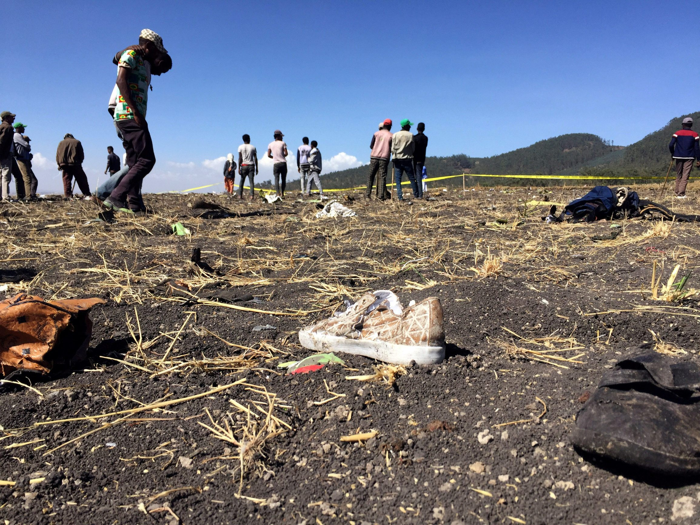 People walk at the scene of the Ethiopian Airlines Flight ET 302 plane crash, near the town of Bishoftu, southeast of Addis Ababa, Ethiopia March 10, 2019. REUTERS/Tiksa Negeri     TPX IMAGES OF THE DAY