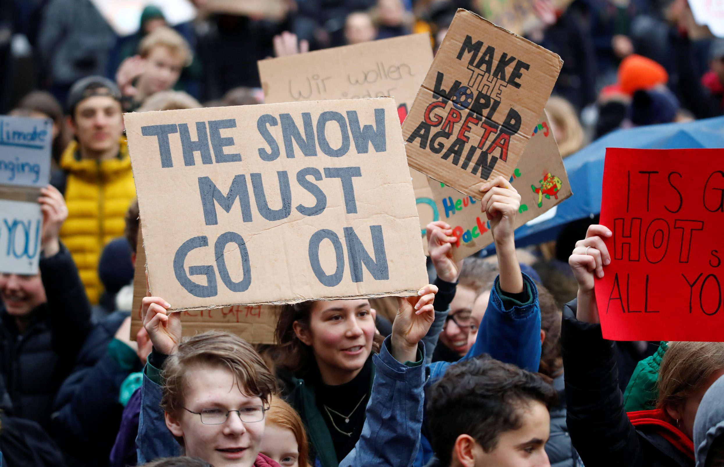 Students hold placards to support Swedish environmental campaigner Greta Thunberg during a strike from school demanding action on climate change at the town hall square of Duesseldorf, Germany, March 15, 2019.  REUTERS/Wolfgang Rattay