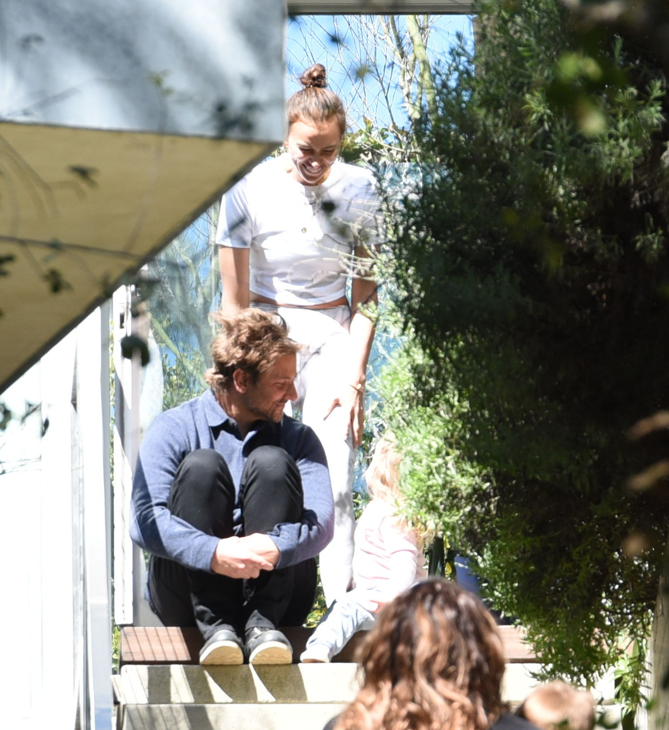 PREMIUM EXCLUSIVE Please contact X17 before any use of these exclusive photos - x17@x17agency.com   So long for the gossips! Bradley Cooper and Irina Shayk offer beautiful love portrait as they are sitting on stairs after Oscar controversy where Bradley was labelled