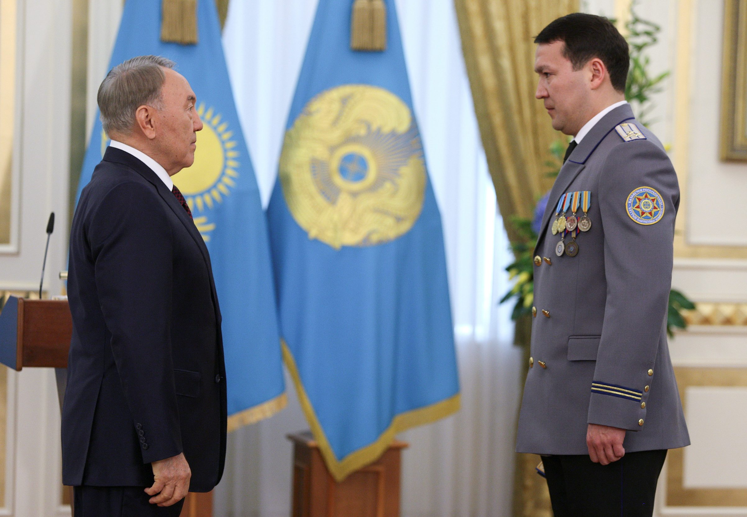 Kazakh President Nursultan Nazarbayev (L) and Deputy Chairman of the National Security Committee Samat Abish attend an awarding ceremony in Astana, Kazakhstan May 6, 2014. Picture taken May 6, 2014. REUTERS/Mukhtar Kholdorbekov