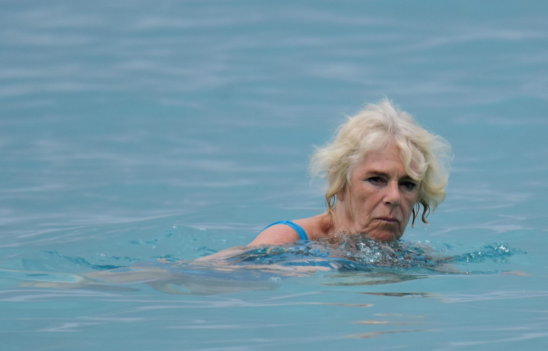 *PREMIUM EXCLUSIVE* Camilla, Duchess of Cornwall, pictured in an aqua-blue swimsuit on the beach in Barbados. Camilla, and husband Prince Charles, are touring the Caribbean representing the Queen at the behest of the Foreign Office. The highlight of their trip is a four-day tour of Cuba beginning on March 24 - the first by members of the monarchy. 18 Mar 2019, Image: 420534258, License: Rights-managed, Restrictions: World Rights, Model Release: no, Credit line: Profimedia, Mega Agency