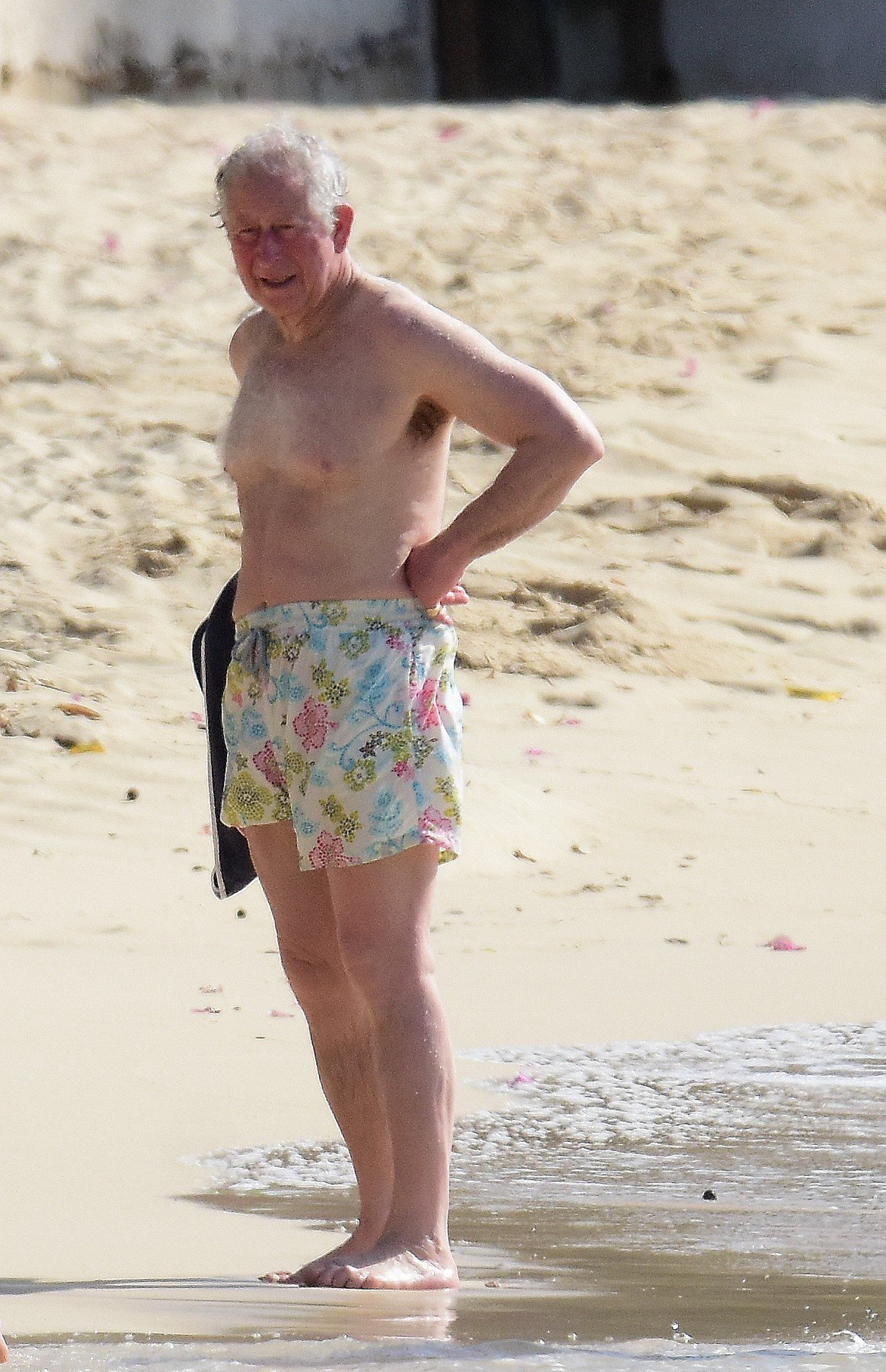 *PREMIUM EXCLUSIVE* Prince Charles and wife Camilla, Duchess of Cornwall,  pictured on the beach in Barbados. The Prince of Wales, 70, showed off his trim frame in natty floral trunks while Camilla, 71, wore an aqua-blue one-piece swimsuit. Camilla and Charles are touring the Caribbean representing the Queen at the behest of the Foreign Office. The highlight of their trip is a four-day tour of Cuba beginning on March 24 - the first by members of the monarchy. 18 Mar 2019, Image: 420538257, License: Rights-managed, Restrictions: World Rights, Model Release: no, Credit line: Profimedia, Mega Agency