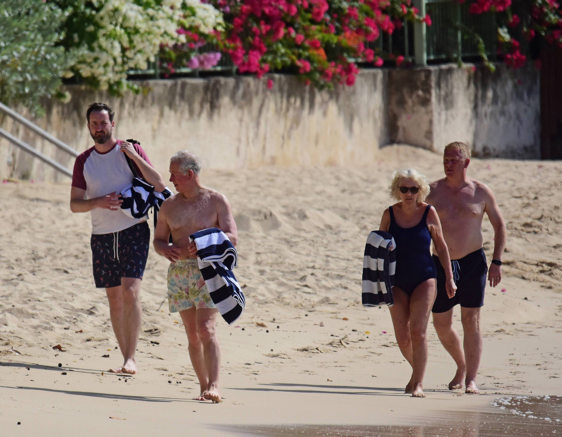 *PREMIUM EXCLUSIVE* Prince Charles and wife Camilla, Duchess of Cornwall,  pictured on the beach in Barbados. The Prince of Wales, 70, showed off his trim frame in floral trunks while Camilla, 71, wore an aqua-blue one-piece swimsuit. Camilla and Charles are touring the Caribbean representing the Queen at the behest of the Foreign Office. The highlight of their trip is a four-day tour of Cuba beginning on March 24 - the first by members of the monarchy. 18 Mar 2019, Image: 420540072, License: Rights-managed, Restrictions: World Rights, Model Release: no, Credit line: Profimedia, Mega Agency