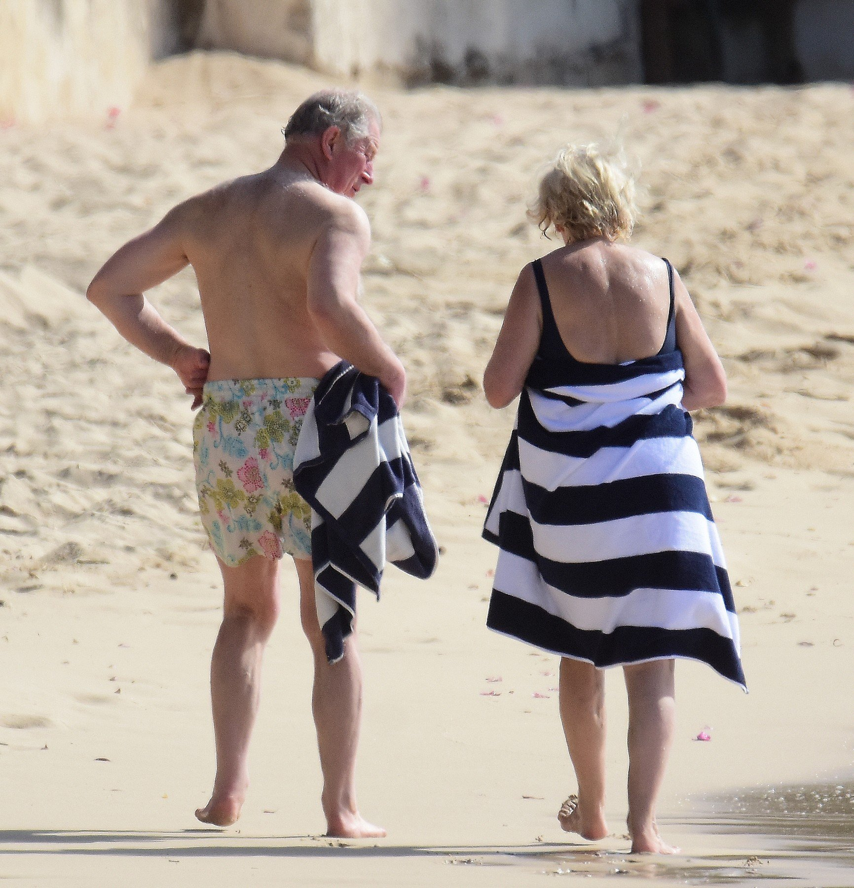 *PREMIUM EXCLUSIVE* Prince Charles and wife Camilla, Duchess of Cornwall,  pictured on the beach in Barbados. The Prince of Wales, 70, showed off his trim frame in floral trunks while Camilla, 71, wore an aqua-blue one-piece swimsuit. Camilla and Charles are touring the Caribbean representing the Queen at the behest of the Foreign Office. The highlight of their trip is a four-day tour of Cuba beginning on March 24 - the first by members of the monarchy. 18 Mar 2019, Image: 420540145, License: Rights-managed, Restrictions: World Rights, Model Release: no, Credit line: Profimedia, Mega Agency