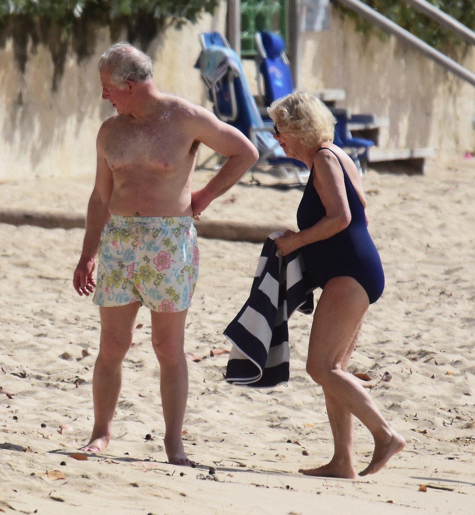 *PREMIUM EXCLUSIVE* Prince Charles and wife Camilla, Duchess of Cornwall,  pictured on the beach in Barbados. The Prince of Wales, 70, showed off his trim frame in floral trunks while Camilla, 71, wore an aqua-blue one-piece swimsuit. Camilla and Charles are touring the Caribbean representing the Queen at the behest of the Foreign Office. The highlight of their trip is a four-day tour of Cuba beginning on March 24 - the first by members of the monarchy. 18 Mar 2019, Image: 420540148, License: Rights-managed, Restrictions: World Rights, Model Release: no, Credit line: Profimedia, Mega Agency