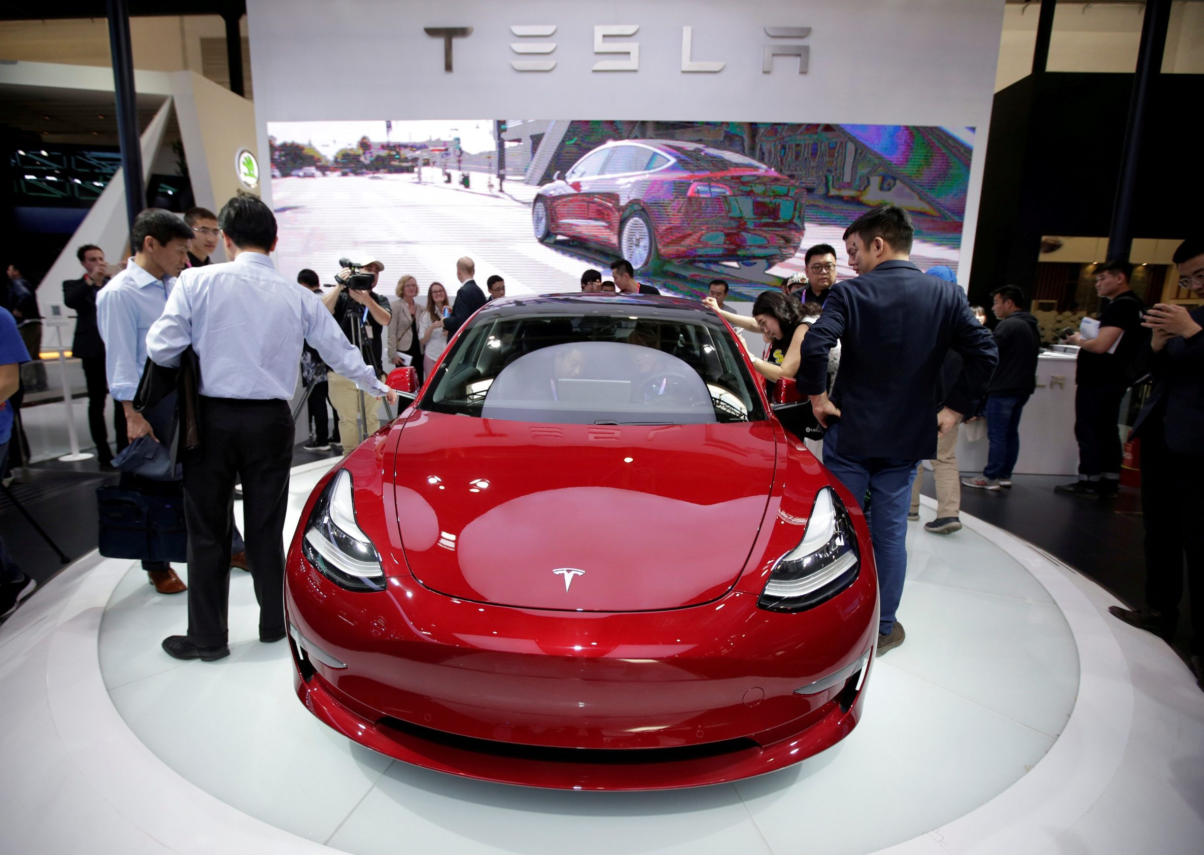 FILE PHOTO: A Tesla Model 3 car is displayed during a media preview at the Auto China 2018 motor show in Beijing, China April 25, 2018. REUTERS/Jason Lee/File Photo